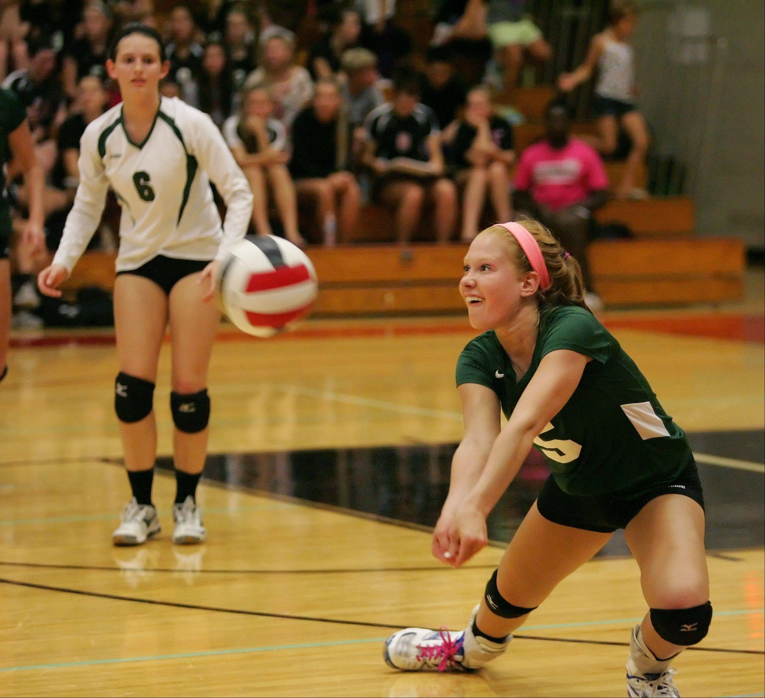 Glenbard West's Madeleine Payne, left, and Meg DeMaar during Tuesday's volleyball match against Glenbard East in Lombard.