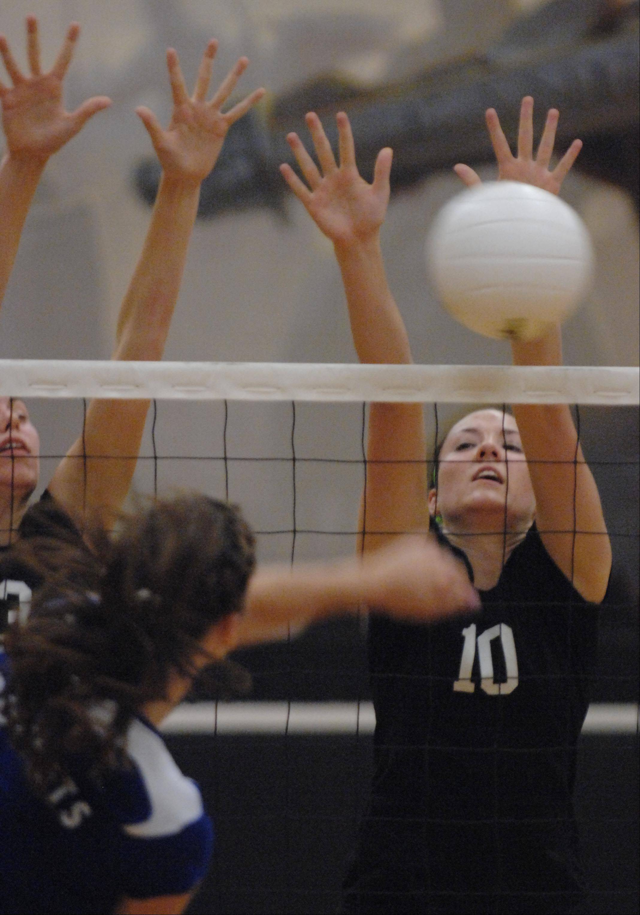 Kaneland's Keri Groen, right, and Ellie Dunn block a shot by Burlington Central's Lexie Bouza Tuesday in Maple Park.