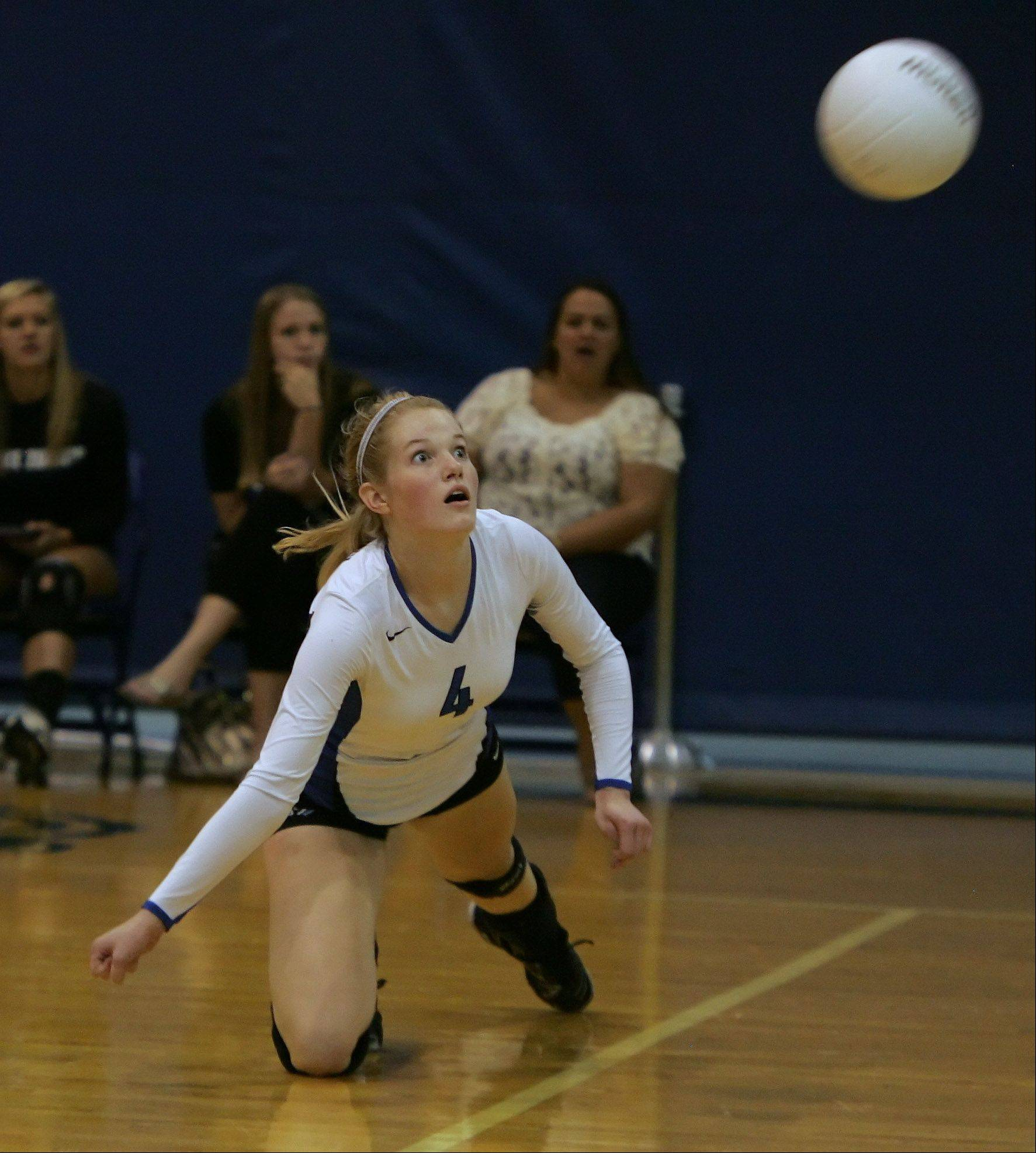 Lake Zurich's Kiley McPeek dives for the ball during the Prairie Ridge at Lake Zurich girls volleyball Tuesday.