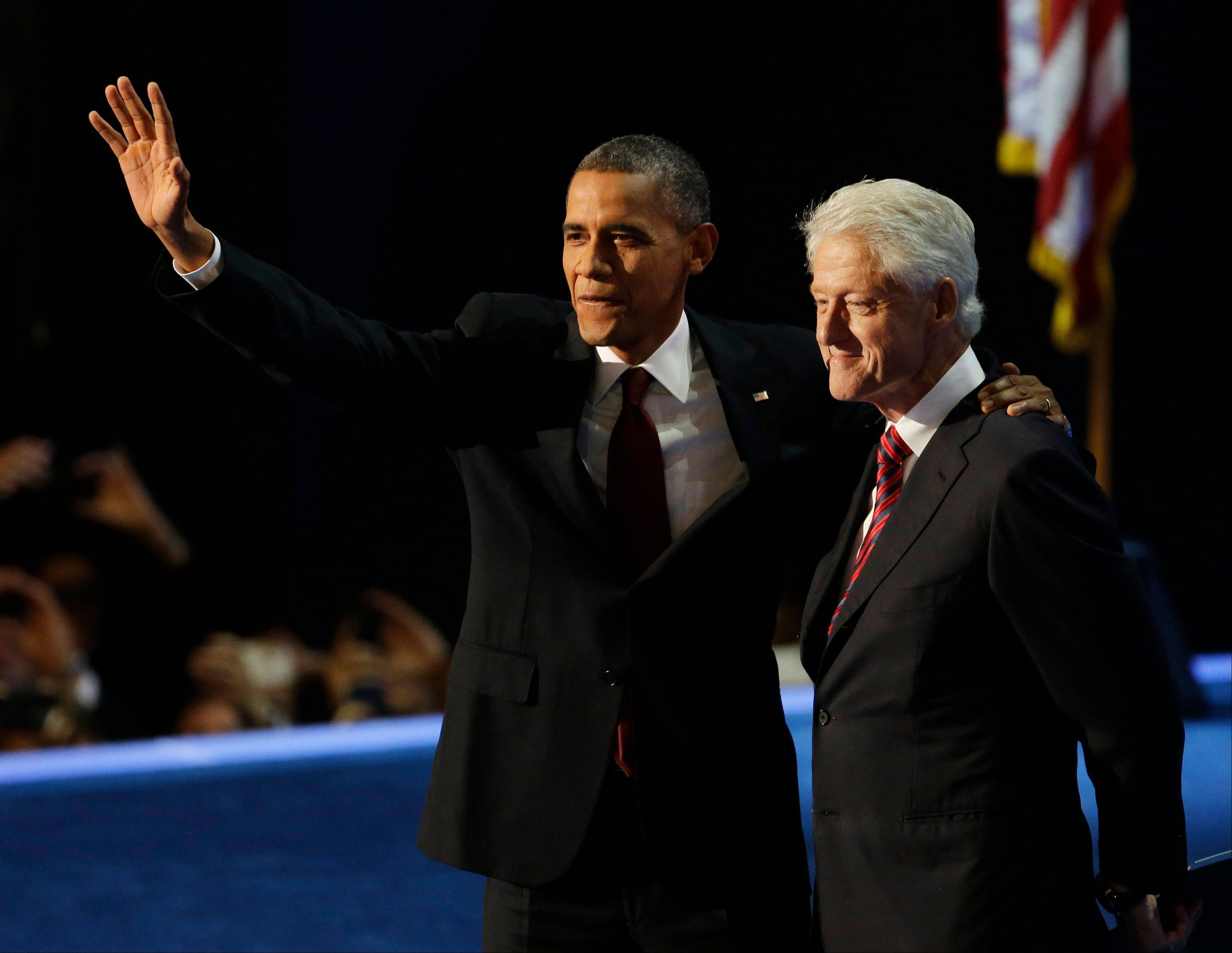 President Barack Obama waves with former President Bill Clinton after Clinton�s speech to the Democratic National Convention in Charlotte, N.C., on Wednesday, Sept. 5, 2012.