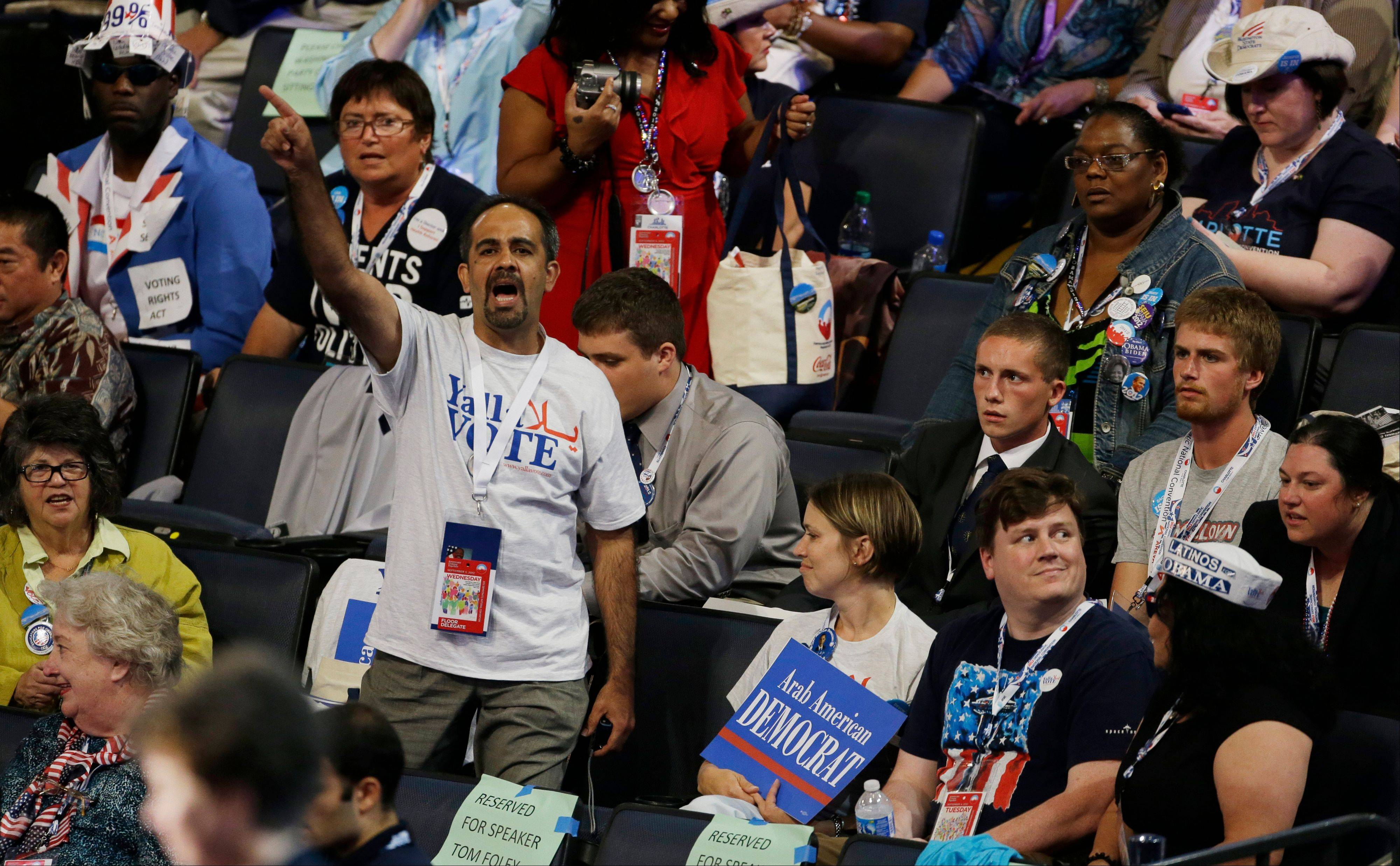A delegate reacts after a vote held on the convention floor to pass a motion presented by Former Ohio Gov. Ted Strickland at the Democratic National Convention in Charlotte, N.C., Wednesday.