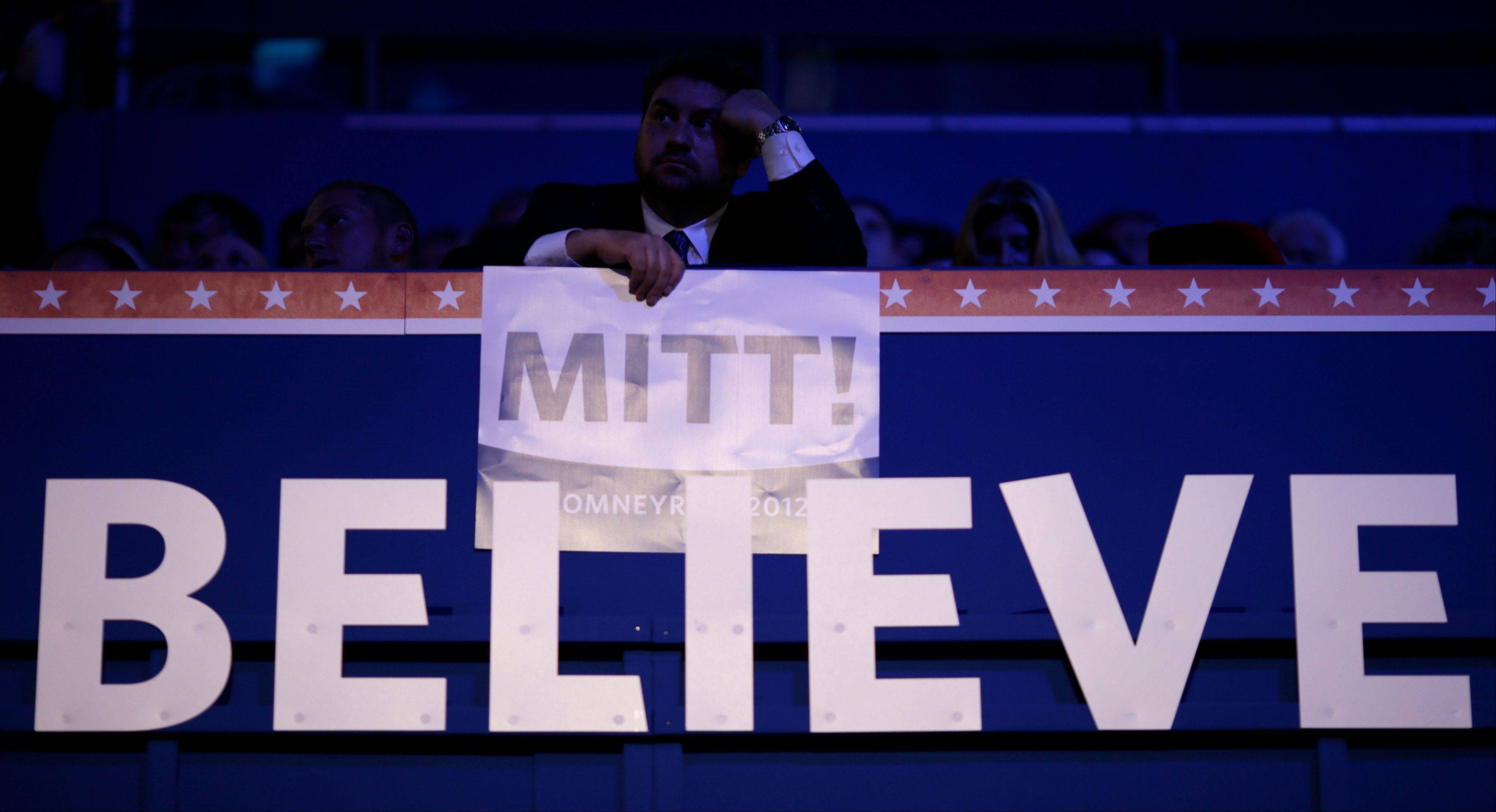 An unidentified delegate holds a sign while watching a video presentation during the Republican National Convention in Tampa, Fla., Aug. 30.