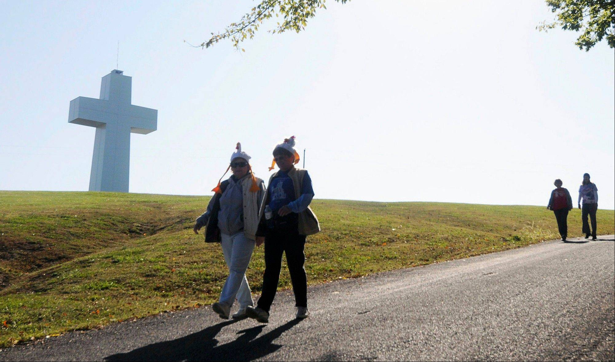 Visitors walk past the 111-foot-high Bald Knob Cross of Peace last October in Alto Pass, Ill.