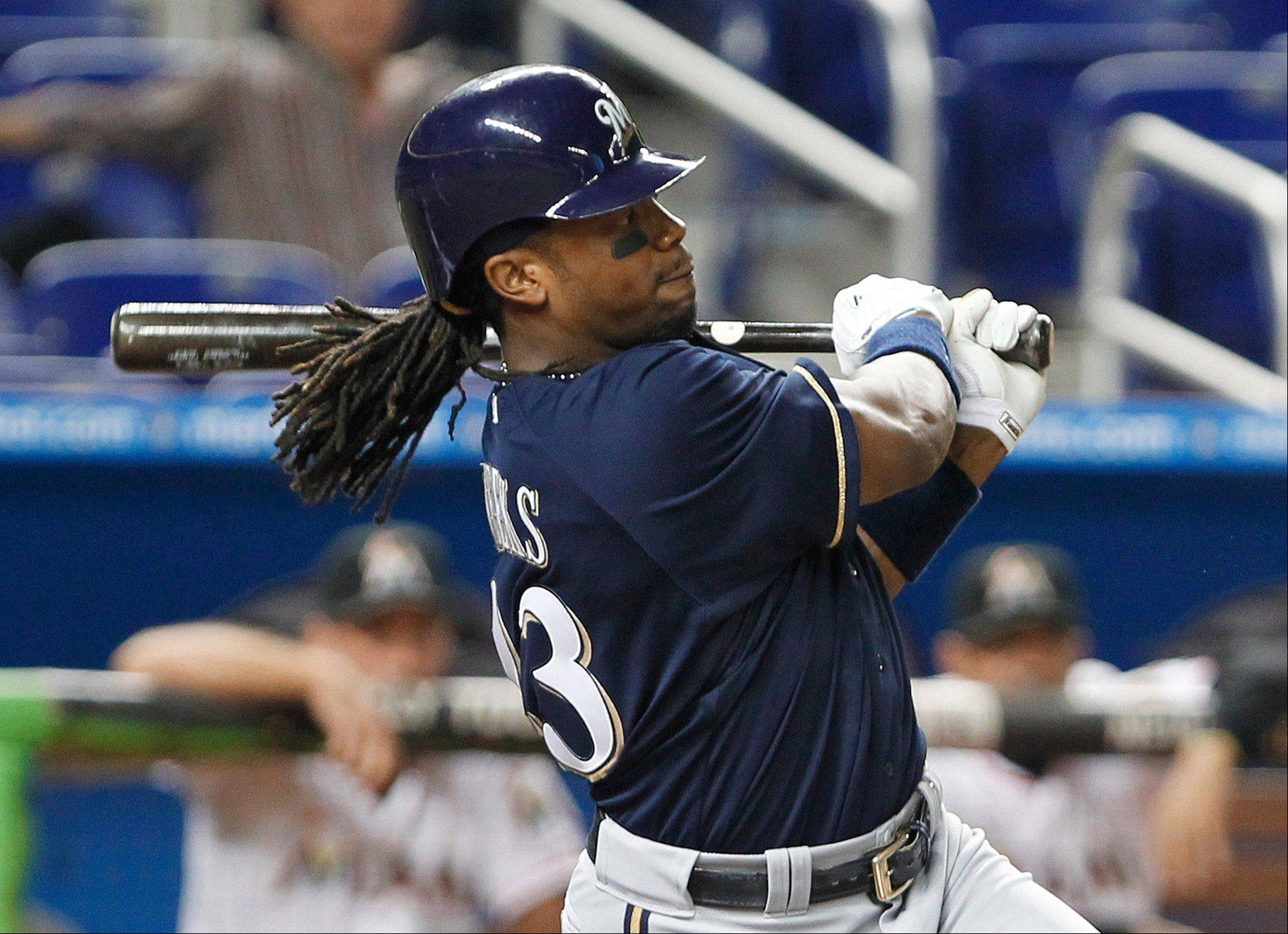 The Brewers� Rickie Weeks watches his two-run home run during the third inning Wednesday in Miami.