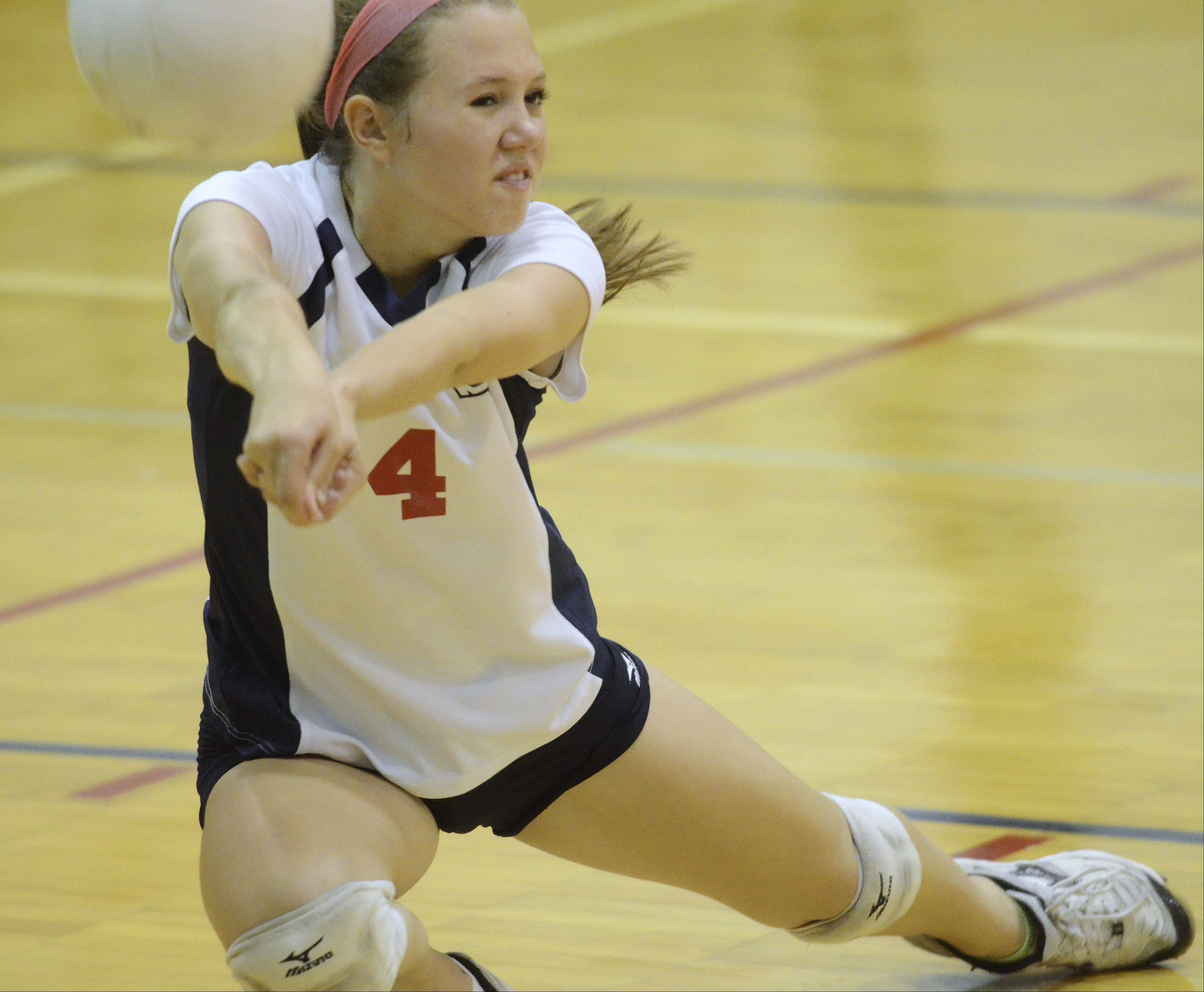 St. Viator�s Caroline Young tries to keep the ball in play during Wednesday�s volleyball match against Resurrection.
