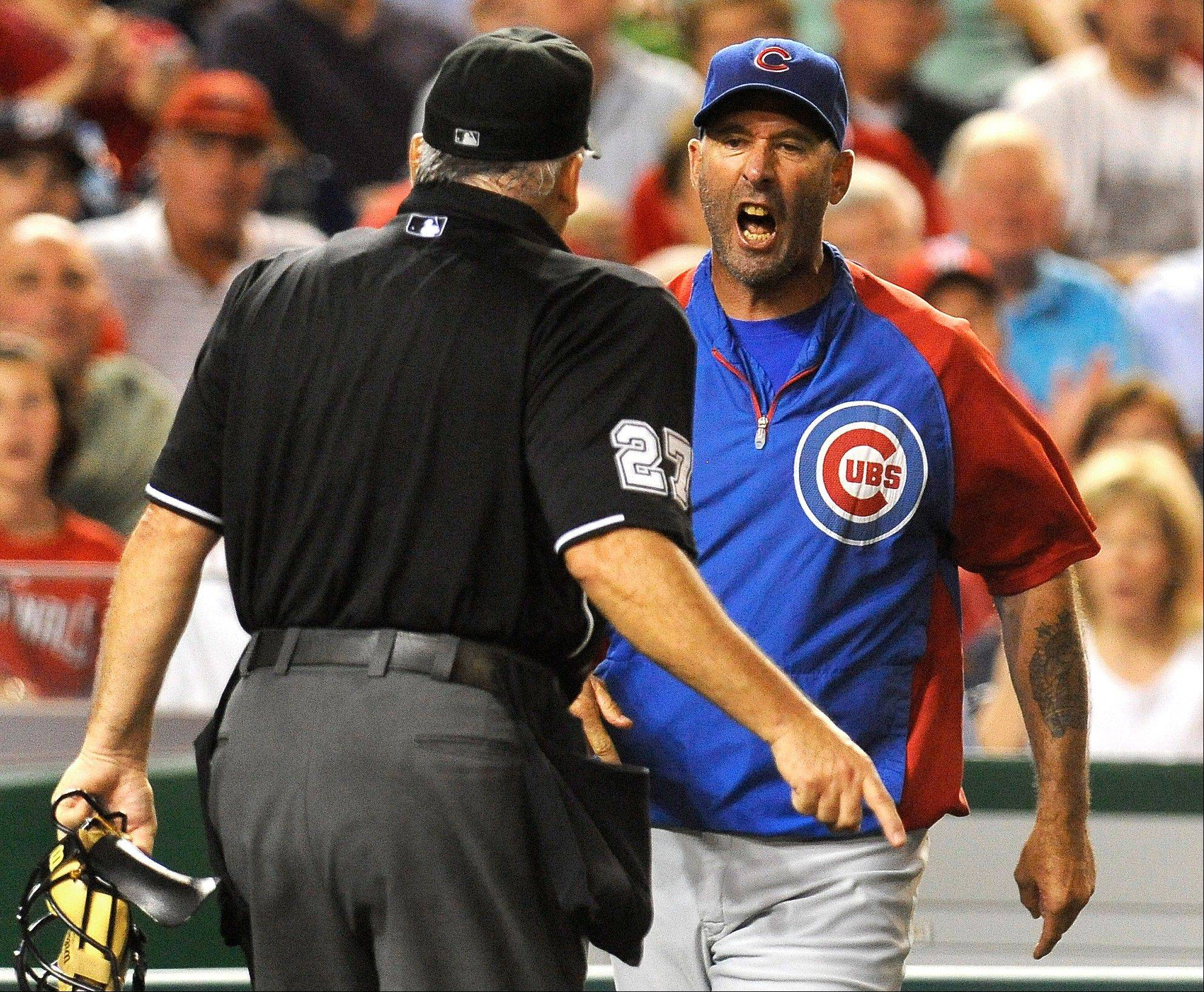 Chicago Cubs manager Dale Sveum, right, confronts home plate umpire Larry Vanover after being thrown out of a baseball game in the fifth inning against the Washington Nationals at Nationals Park, Wednesday, Sept. 5, 2012, in Washington. (AP Photo/Richard Lipski)