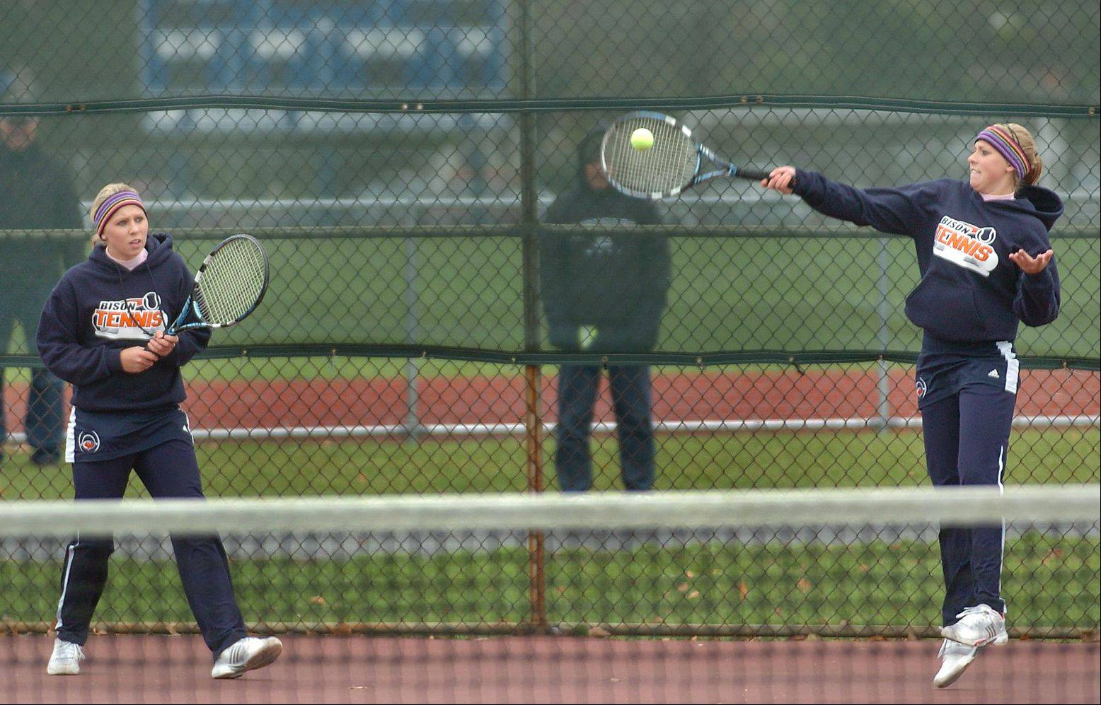 Buffalo Grove�s Lauren, left, and Dana Goggin on first day of the girls state tennis tournament at Buffalo Grove last fall. Back for their senior year, the Goggins lead a Bison team with high hopes this fall.