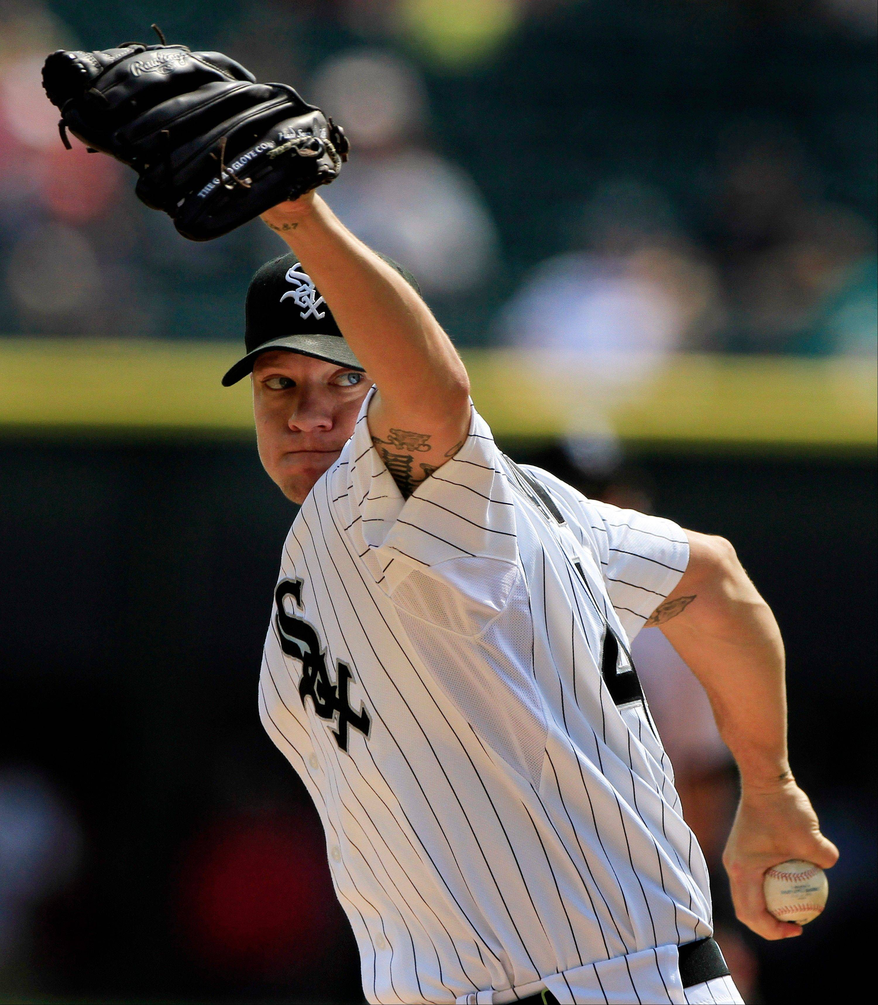 Chicago White Sox starting pitcher Jake Peavy throws to a Minnesota Twins batter during the first inning of a baseball game, Wednesday, Sept. 5, 2012, in Chicago. (AP Photo/John Smierciak)