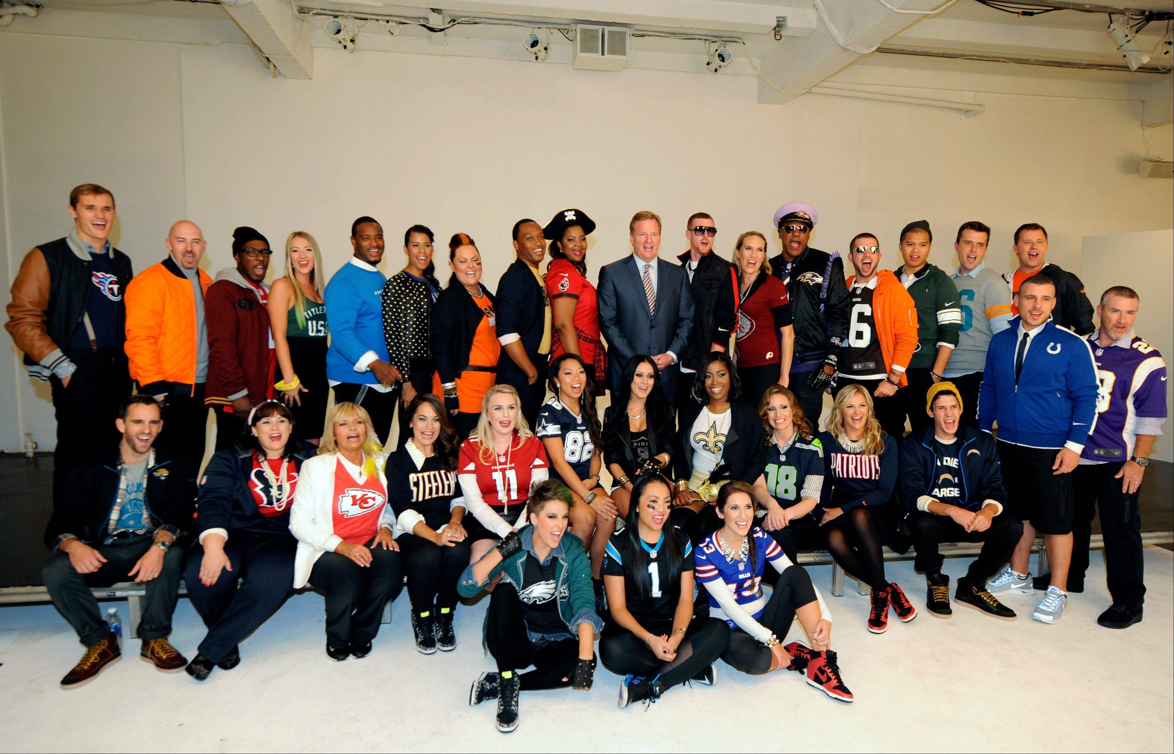 Commissioner Roger Goodell, center, is surrounded by one fan from each of the league�s 32 teams who were chosen to take part in the NFL�s Back to Football Photo Day in New York.