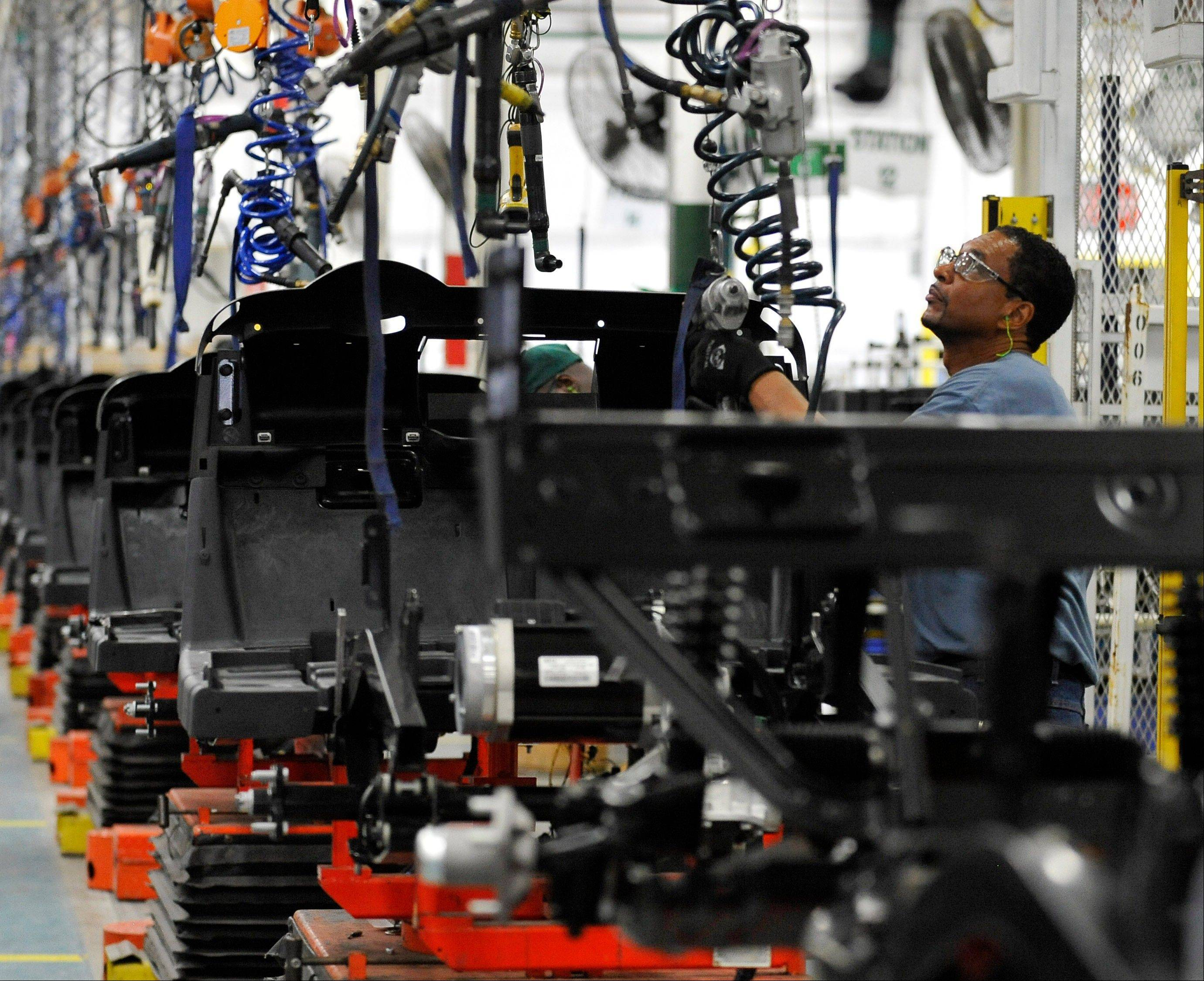 U.S. companies got more output from their workers this spring than initially thought. Productivity rose at a modest 2.2 percent annual rate in the April-June quarter, largely because employers cut back sharply on hiring.