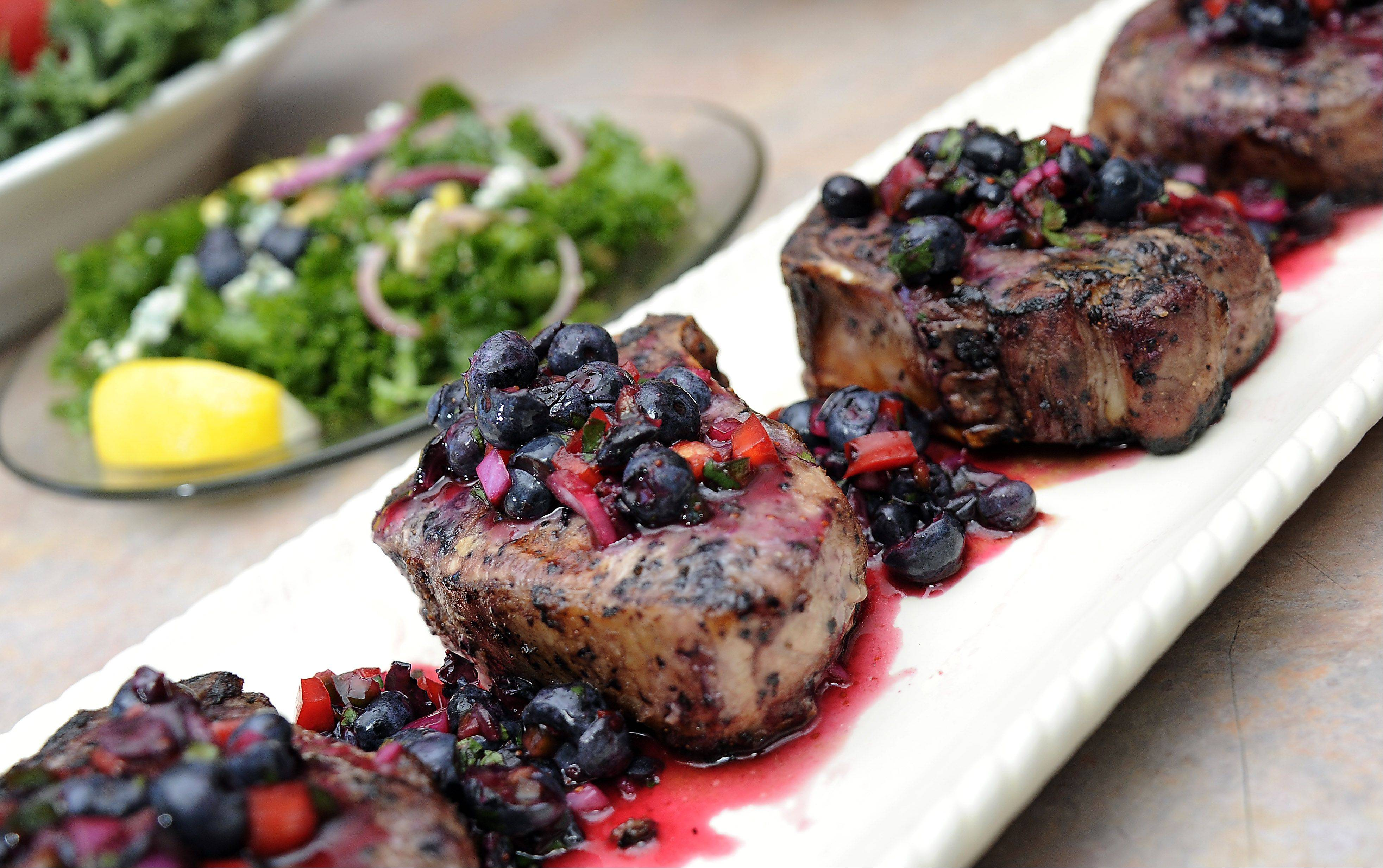 Ronald Nunes serves a kale, blueberry and walnut salad with blueberry salsa-topped pork chops.