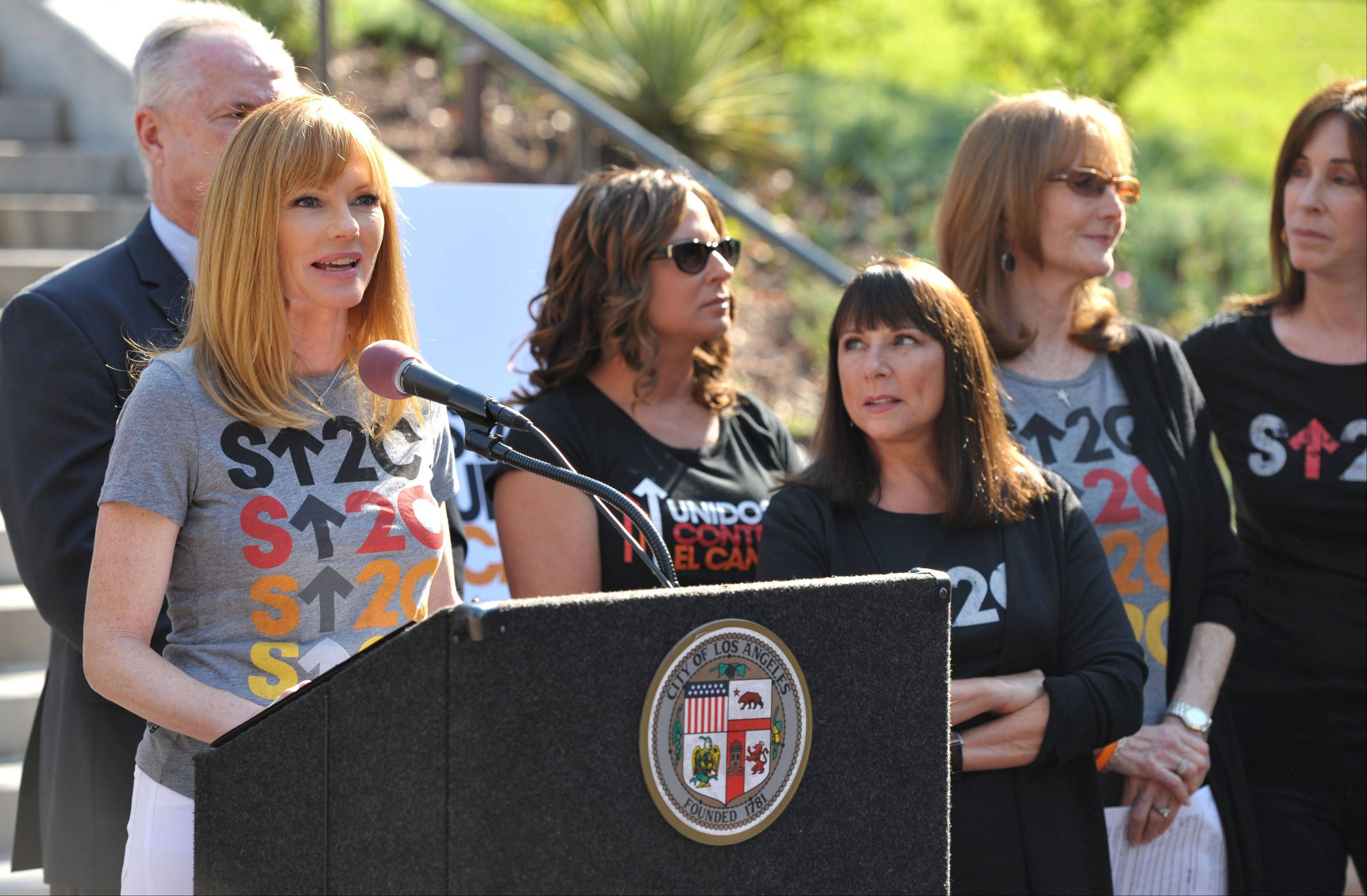 Actress Marg Helgenberger, left, appears at the Stand Up To Cancer Day announcement at Los Angeles City Hall on Tuesday.