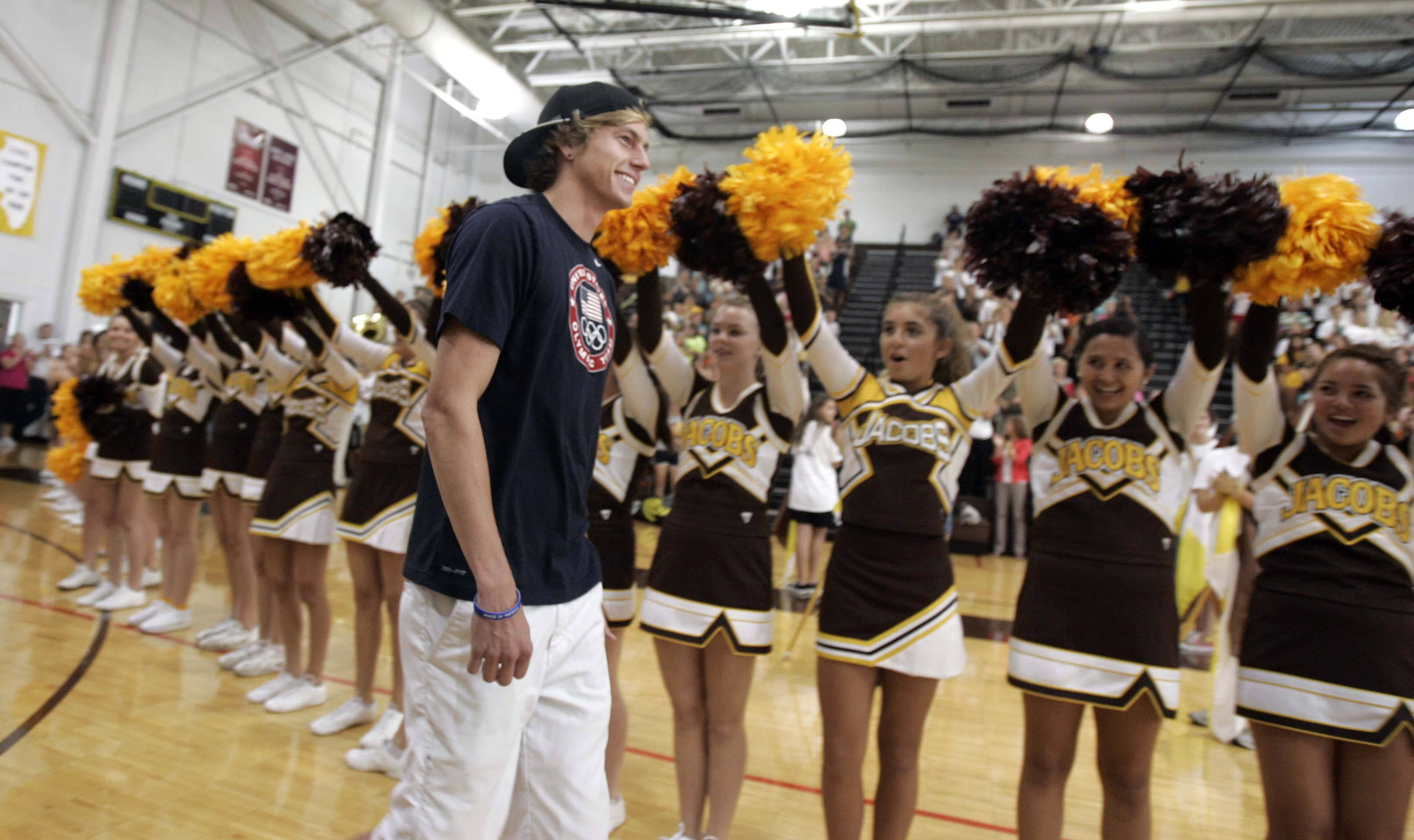 Olympian Evan Jager makes his way through the cheerleaders as he returns to H.D. Jacobs High School in Algonquin Wednesday.