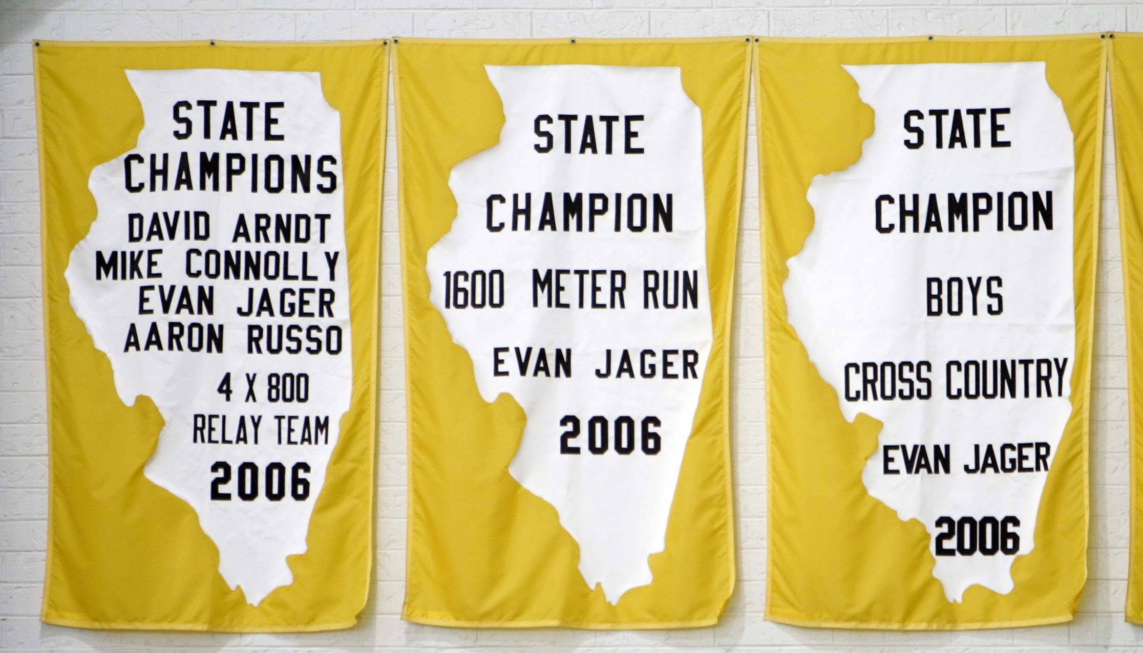 Just a few of the state champion flags that adorn the gymnasium where Olympian Evan Jager returned to H.D. Jacobs High School in Algonquin.