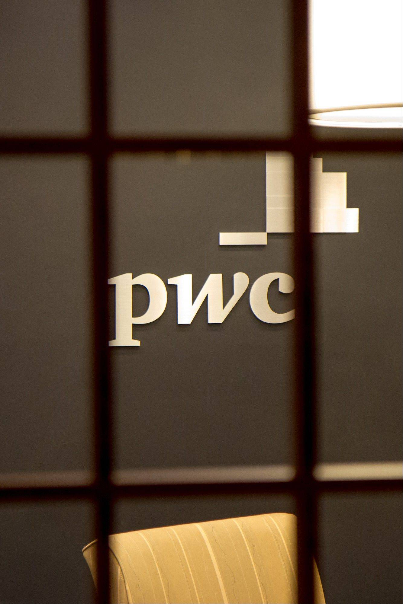 The PricewaterhouseCoopers office in Franklin, Tenn., is seen from outside its doors on Wednesday. The Secret Service said is investigating the reported theft of Mitt Romney's federal tax records during a break-in at the office. The company said there was no evidence Romney tax files were stolen.