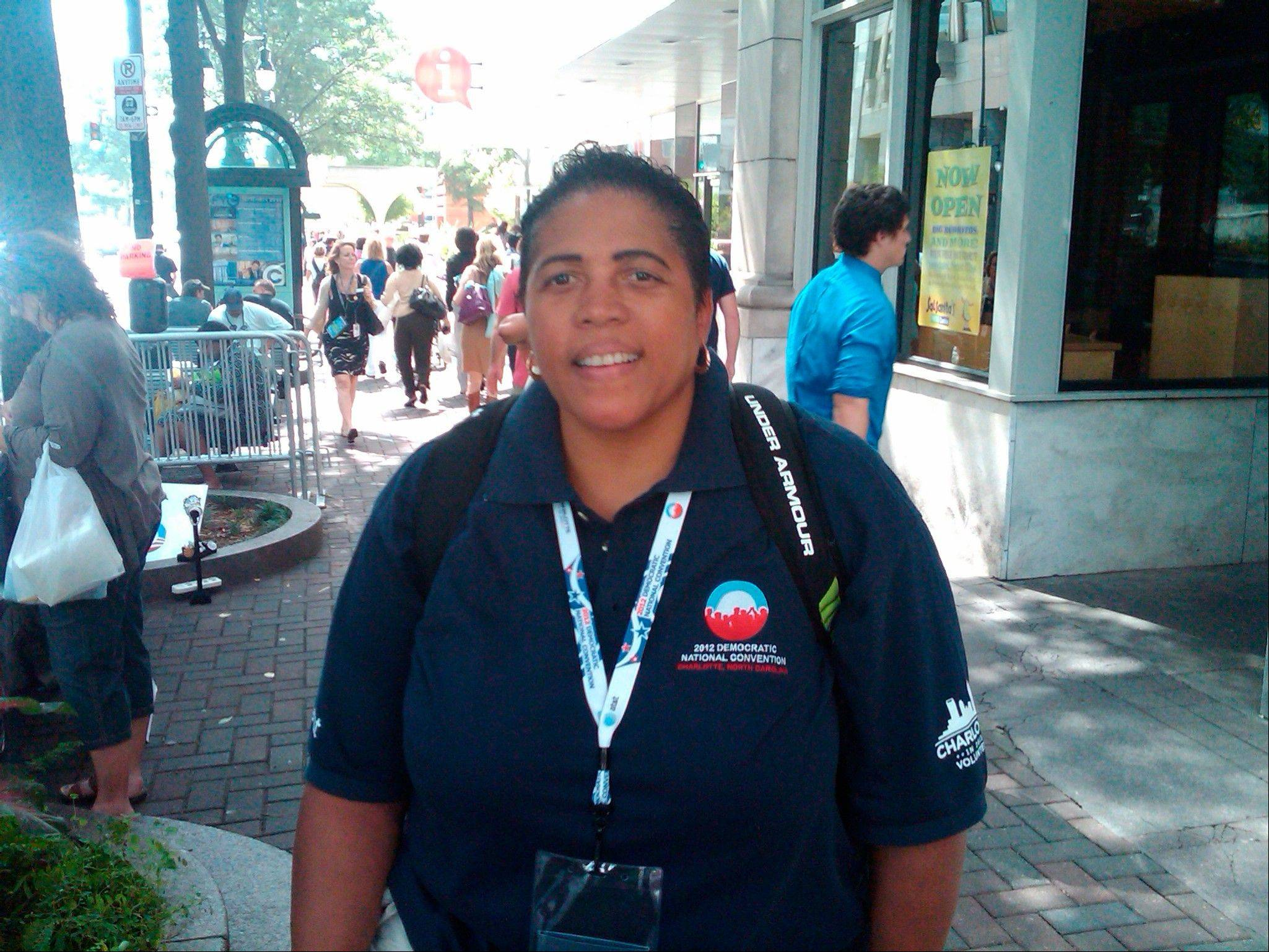 Andrea Chambliss poses for a photo Wednesday in Charlotte, N.C. Chambliss is a volunteer from California who came to Charlotte to see President Obama speak and is disappointed she won't get to be there Thursday after Obama moved his speech.