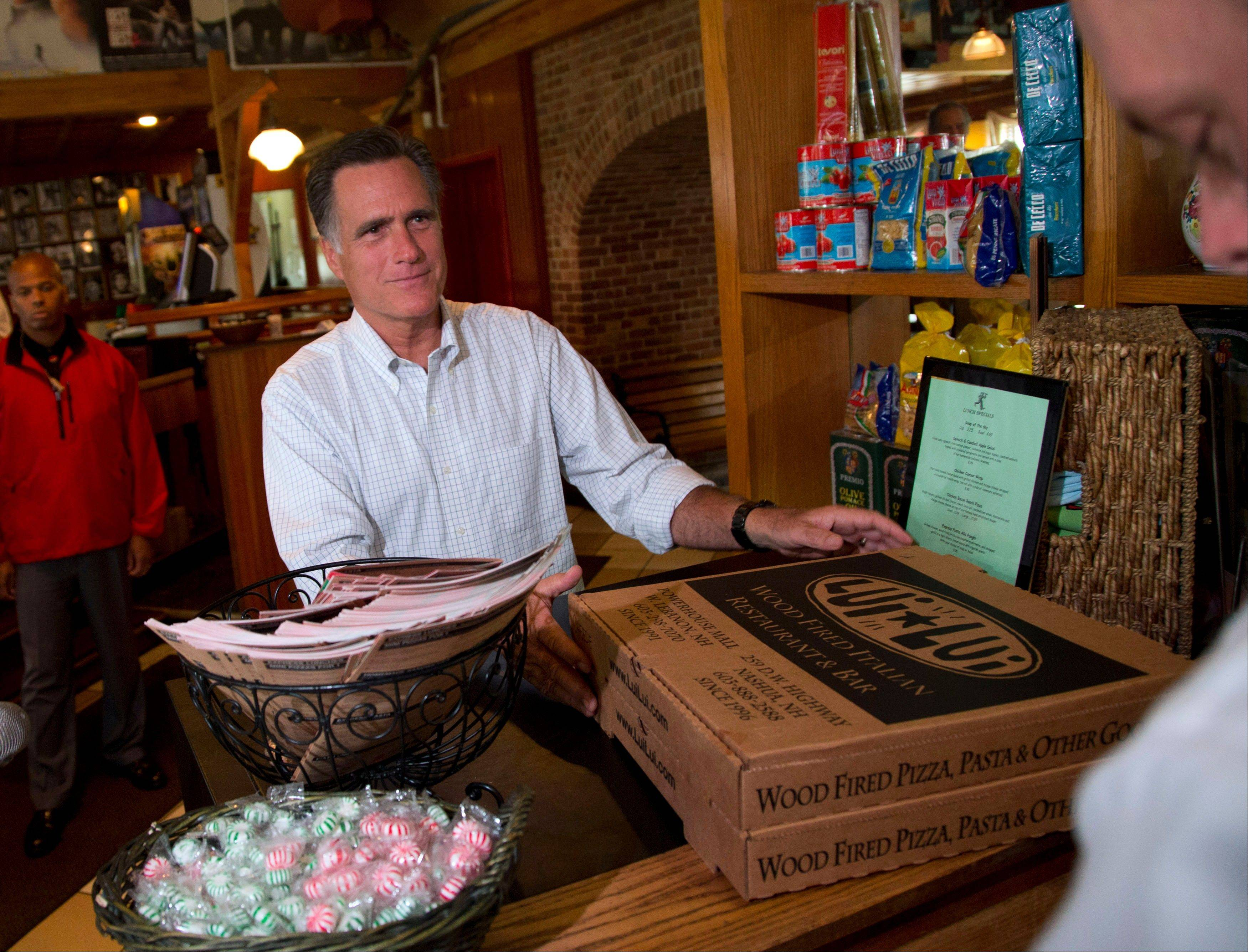 Republican presidential candidate, former Massachusetts Gov. Mitt Romney picks up his order after stopping at Lui-Lui Restaurant on Wednesday in West Lebanon, N.H.