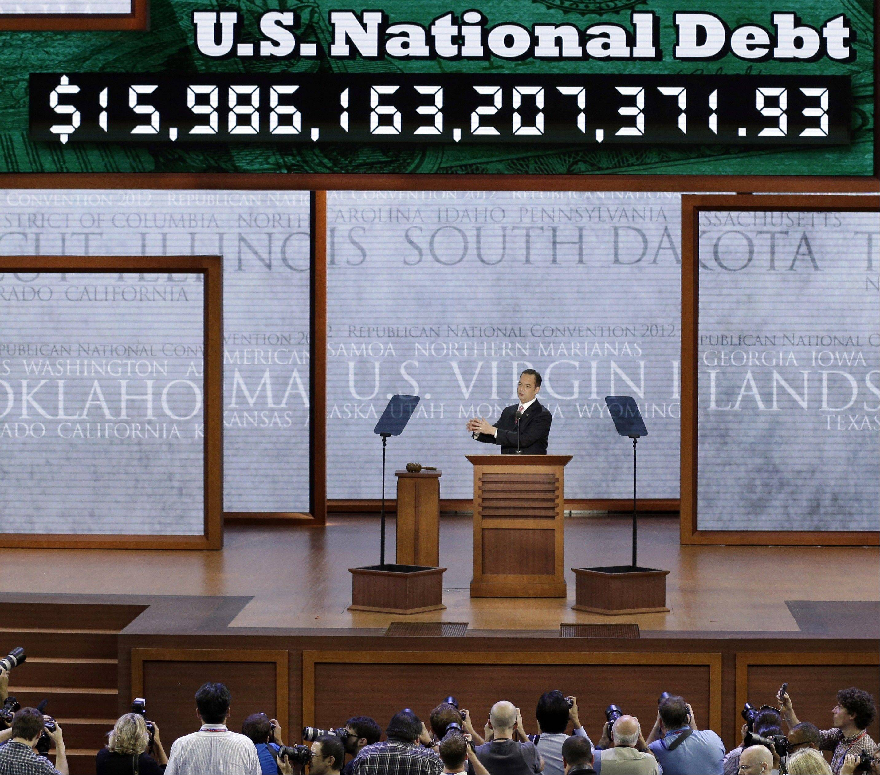 Republican National Committee Chairman Reince Priebus announces the display of the debt ticker during the Republican National Convention in Tampa, Fla., Aug. 27.