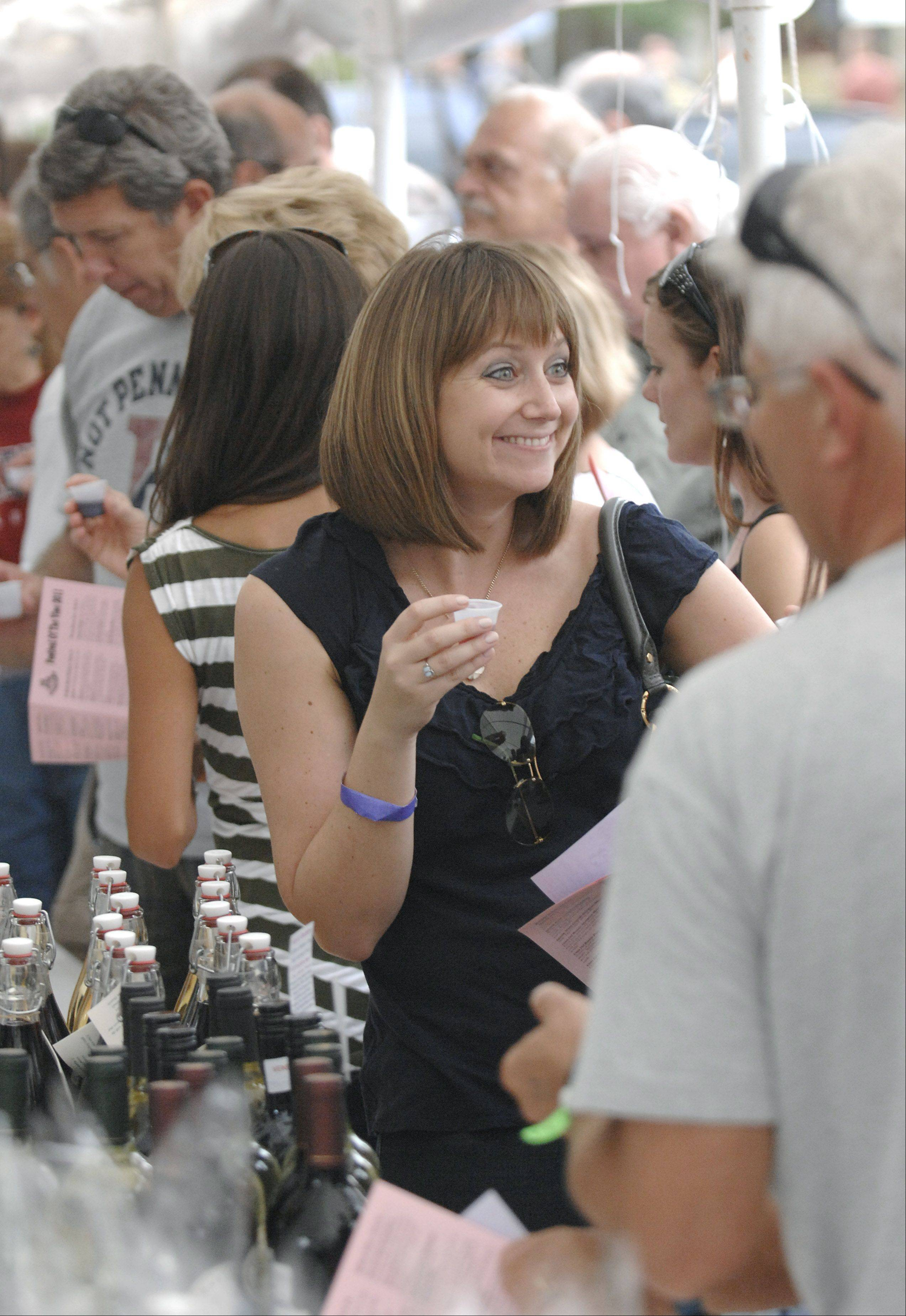 Abby Berlien of Chicago samples wine with her friends at last year's Festival of the Vine in downtown Geneva.