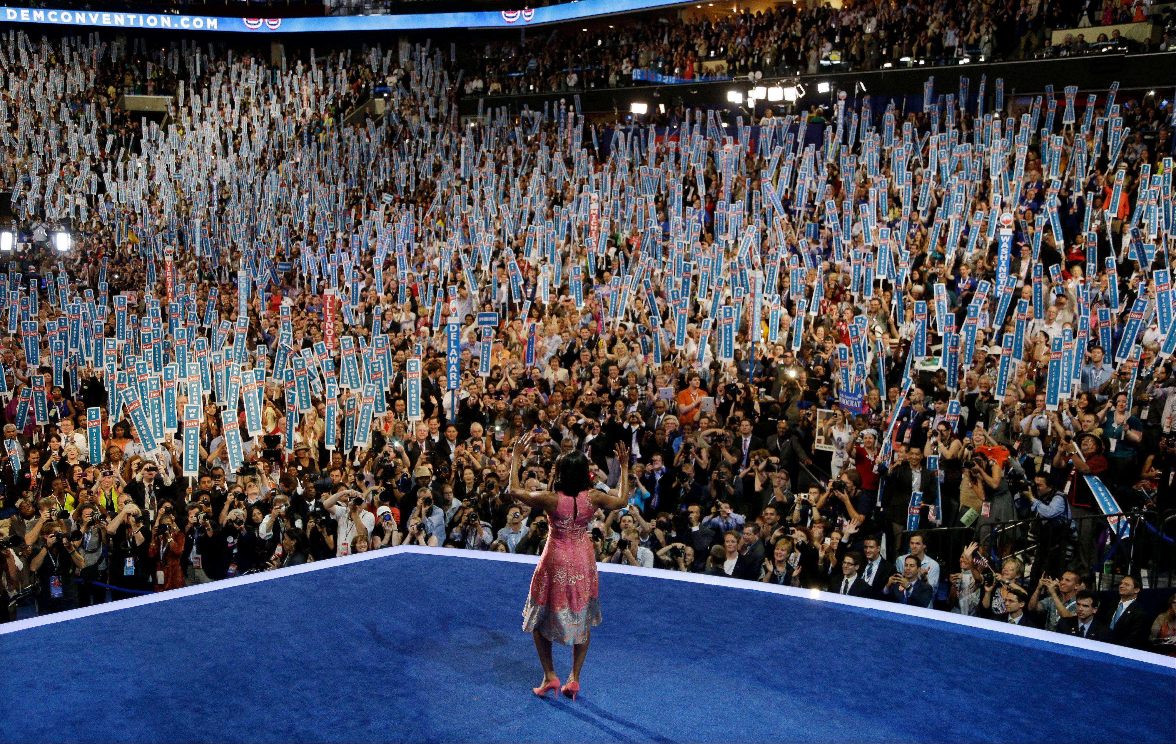 First Lady Michelle Obama walks on stage to speak to the Democratic National Convention in Charlotte, N.C., on Tuesday, Sept. 4, 2012.