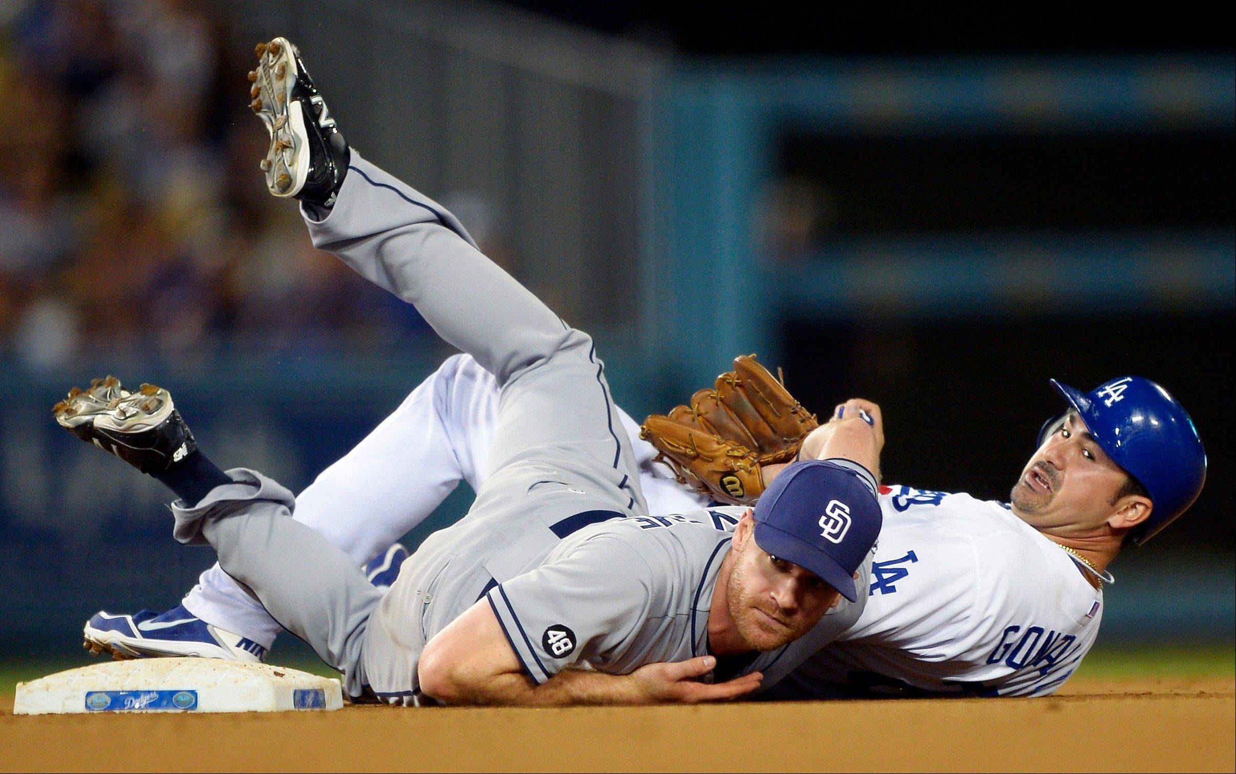 The Dodgers' Adrian Gonzalez, right, is forced out at second as San Diego Padres second baseman Logan Forsythe watches his throw to first during the fifth inning Wednesday in Los Angeles. Matt Kemp was safe at first.