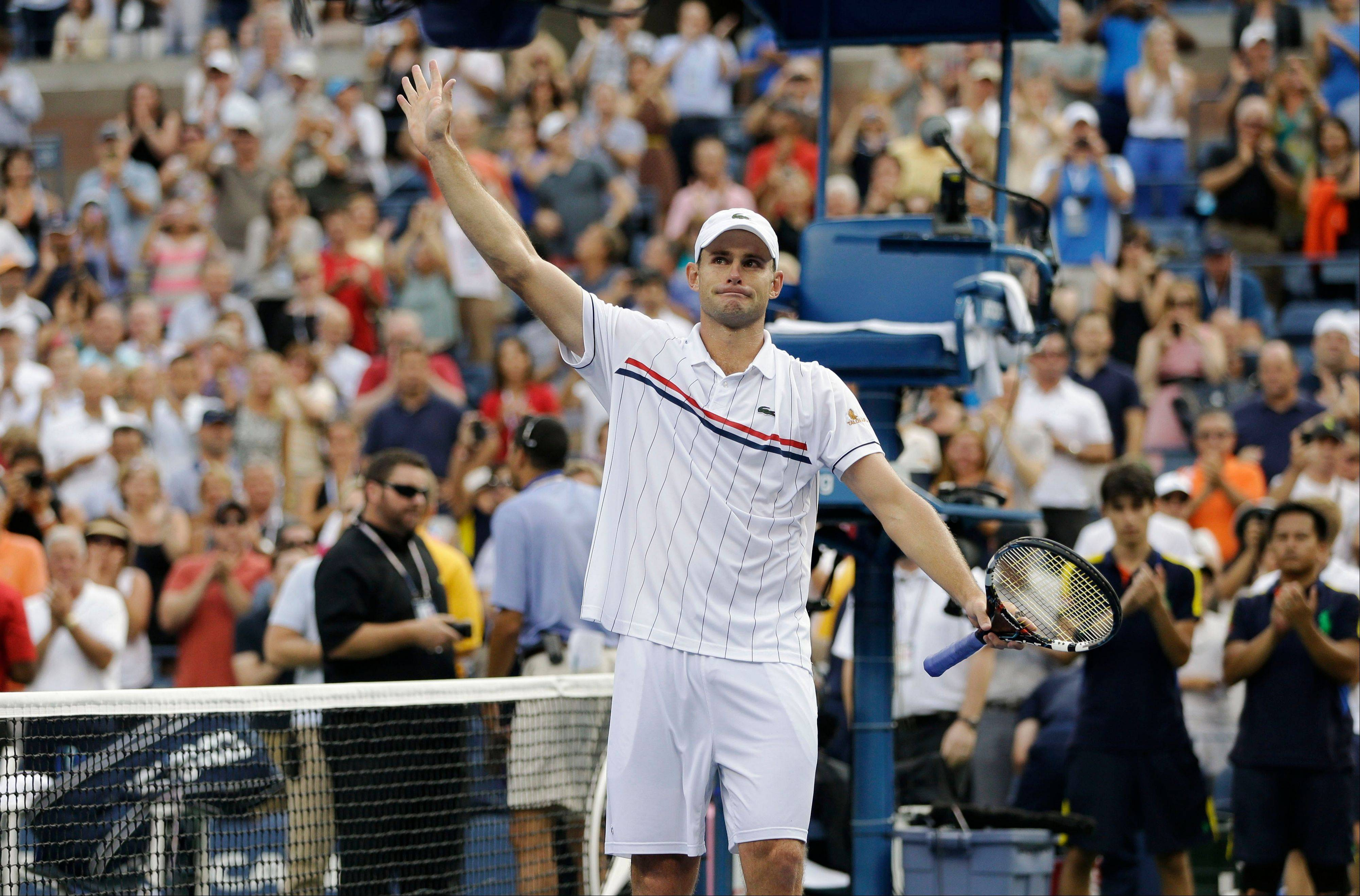 Andy Roddick waves to fans after his loss to Argentina's Juan Martin del Potro in the quarterfinals Wednesday at the U.S. Open in New York. Roddick said he would retire after the match.