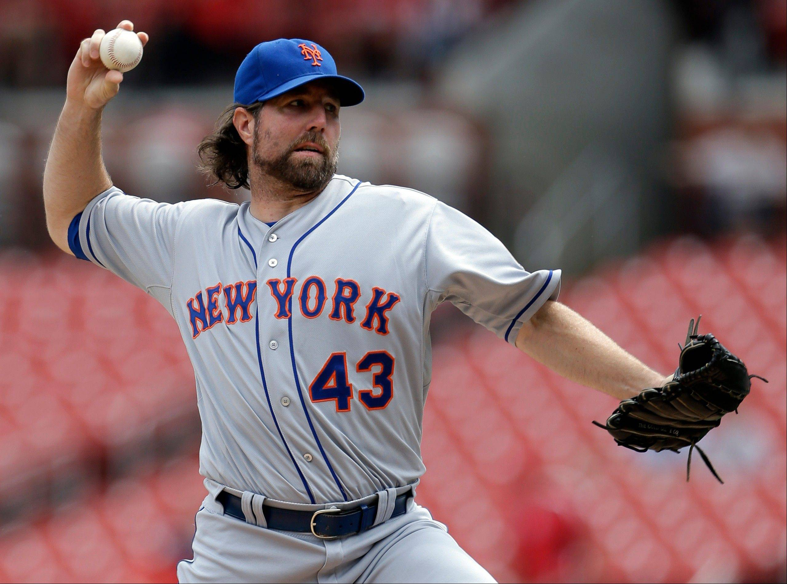 Mets starting pitcher R.A. Dickey allowed two runs in 6 2-3 innings en route to his 18th win Wednesday in St. Louis.