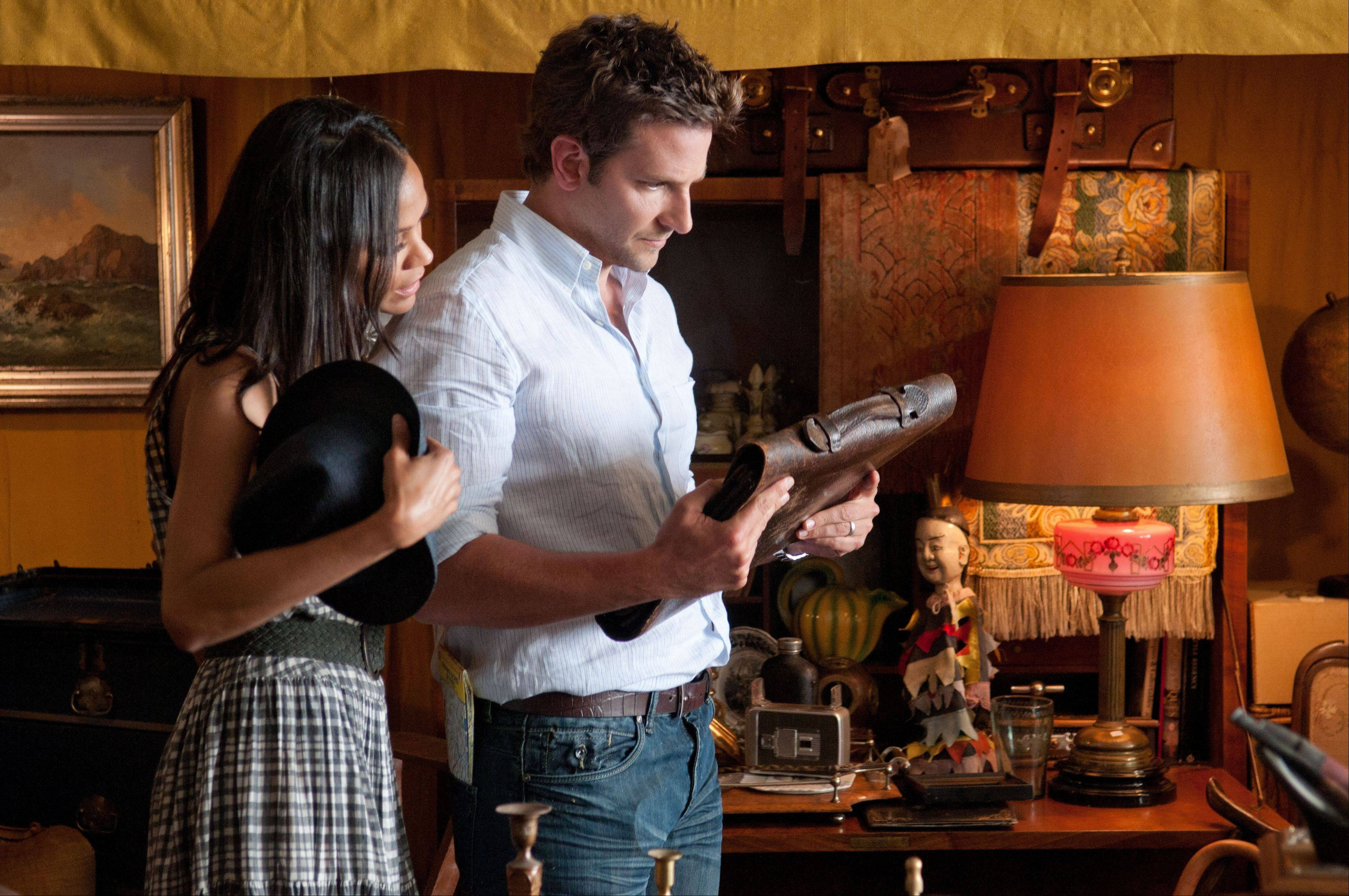 "While on his honeymoon with his supportive wife (Zoe Saldana), a writer (Bradley Cooper) finds a manuscript in an old briefcase in ""The Words."""