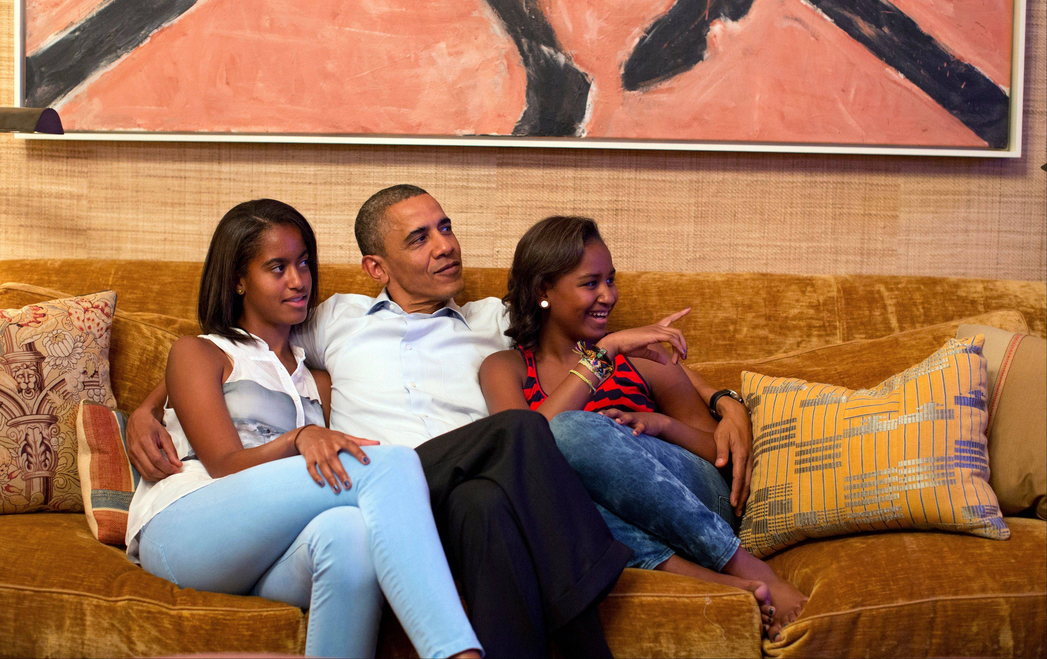 In this Tuesday image originally released by the White House, President Barack Obama and his daughters, Malia, left, and Sasha, watch first lady Michelle Obama speak on television. For many TV viewers, it will surely be a surprise to see how much the Obama daughters have grown when they appear in Charlotte Thursday night.