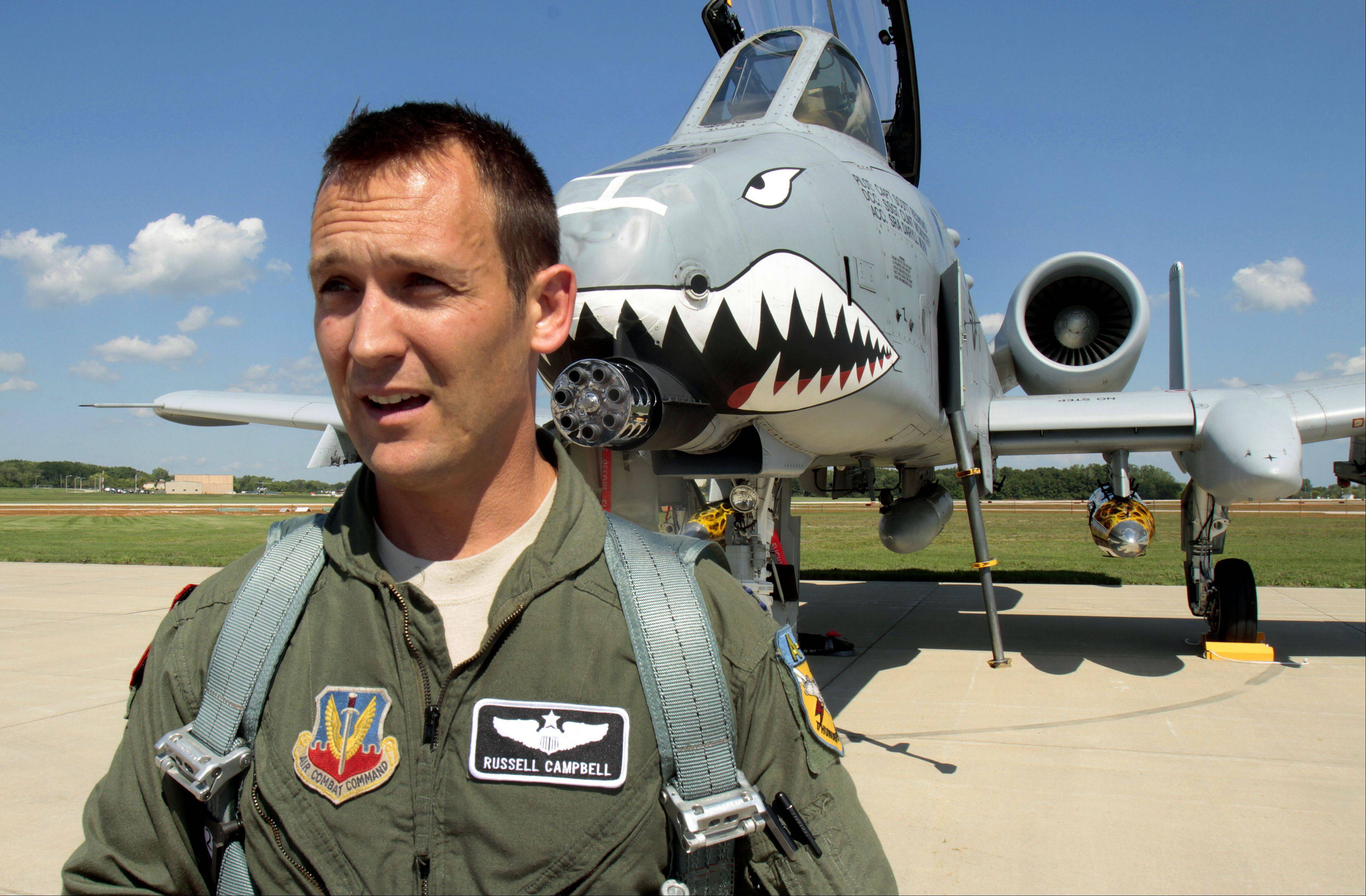 Libertyville native and Air Force Capt. Russell Campbell talks after flying in his A-10 Thunderbolt II into Waukegan Municipal Airport on Thursday. The plane will be used as a backup for the 2012 Wings Over Waukegan air show on Saturday.