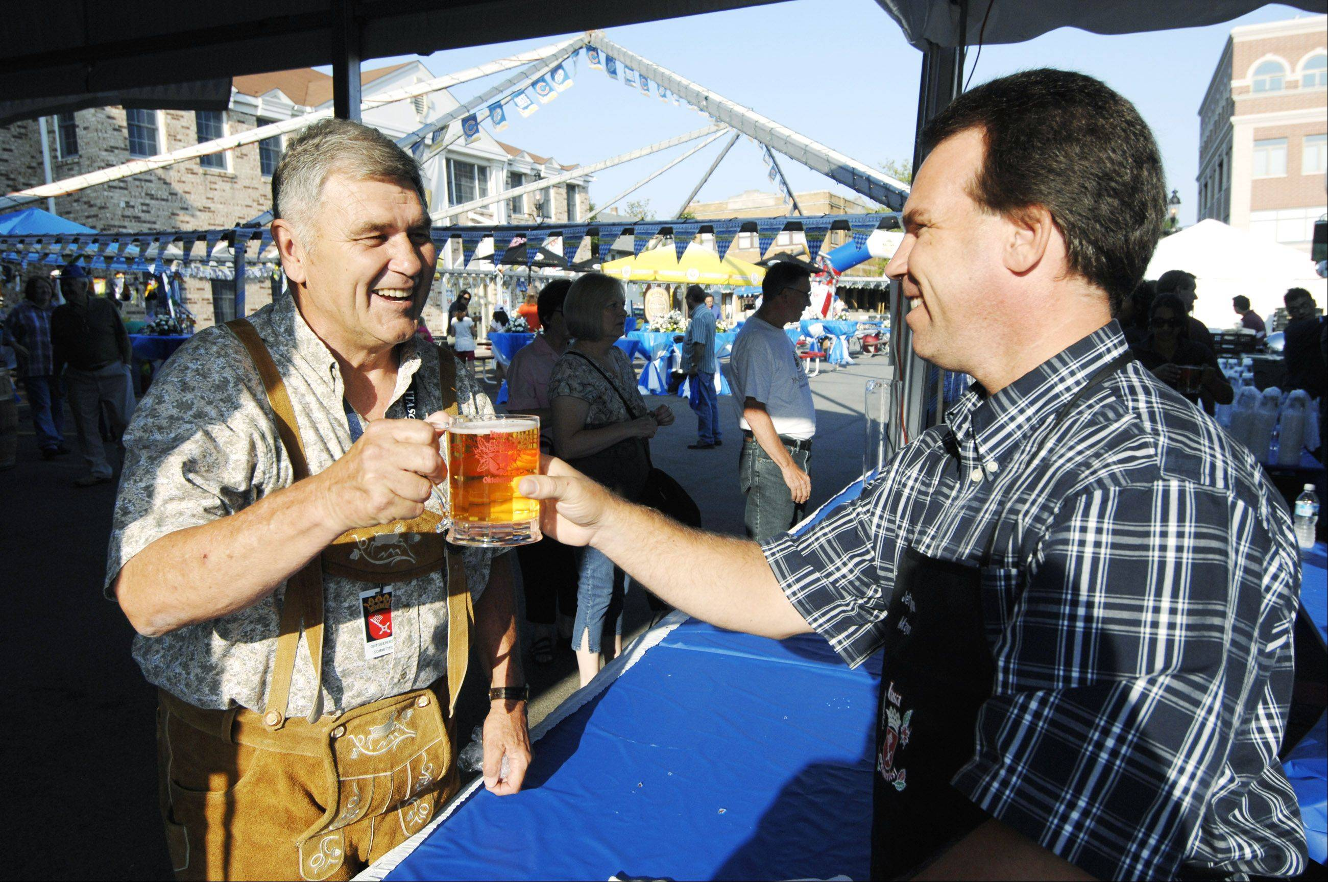 Itasca Mayor Jeff Pruyn, right, will tap the first keg of the village's Oktoberfest around 5 p.m. Friday to open the two-day festival. Event organizer Dan Kompanowski, left, says he bought lederhosen to fit in with the enthusiastic German crowd.