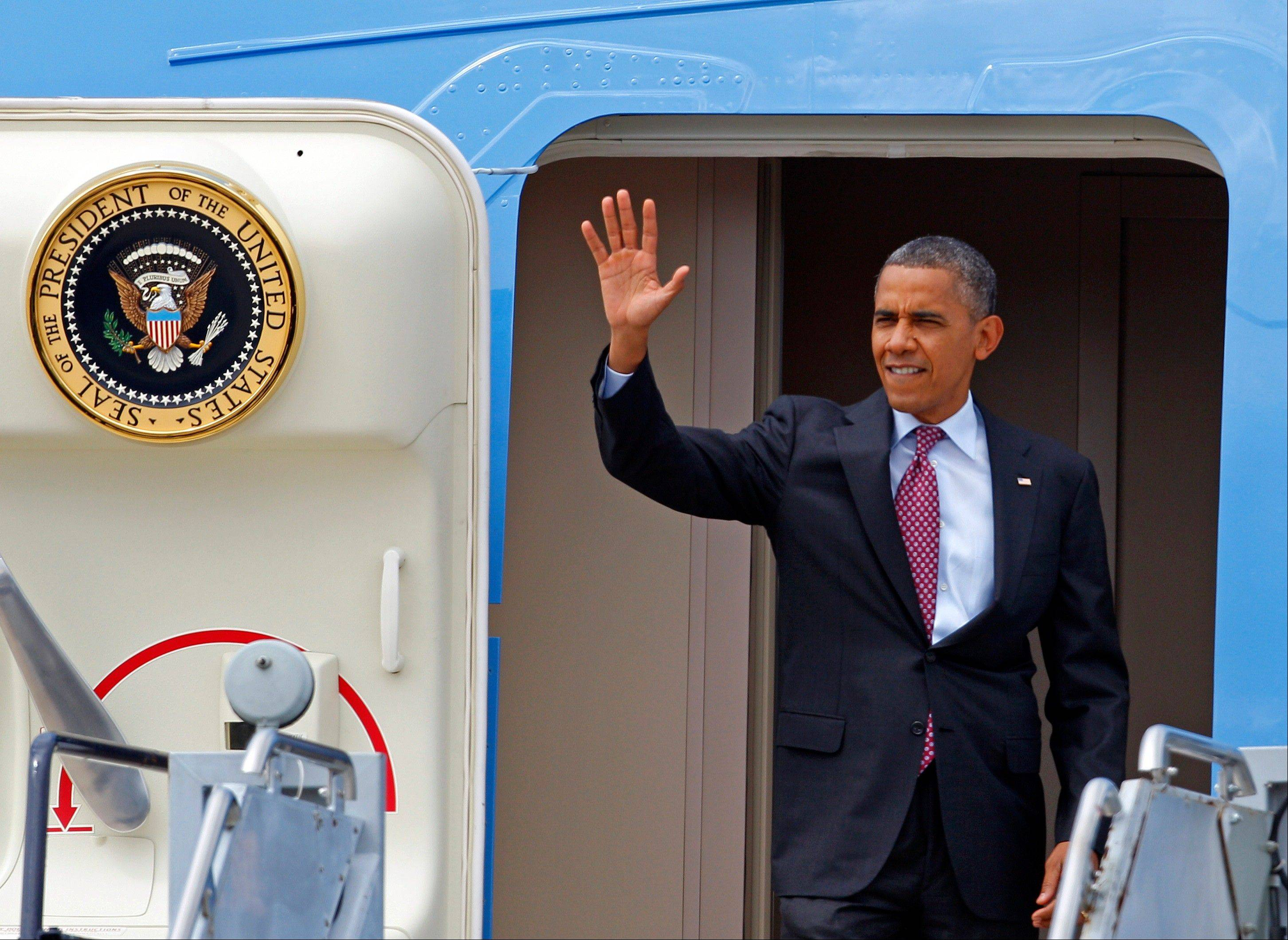 President Barack Obama waves to supporters as he arrives at the Charlotte/Douglas International Airport for the Democratic National Convention in Charlotte, N.C., Wednesday, Sept. 5, 2012.