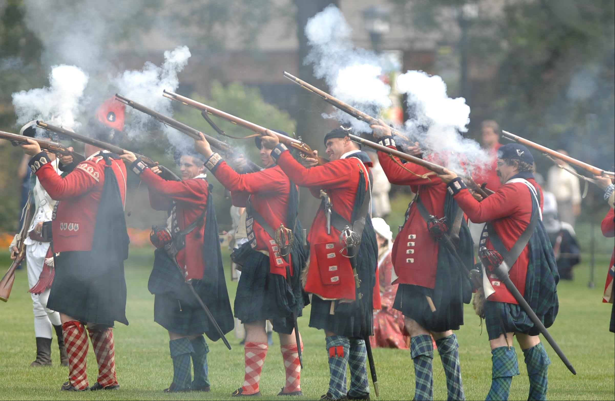 Re-enactors portraying British soldiers will take up their guns in two battles both Saturday and Sunday at Cantigny Park in Wheaton.
