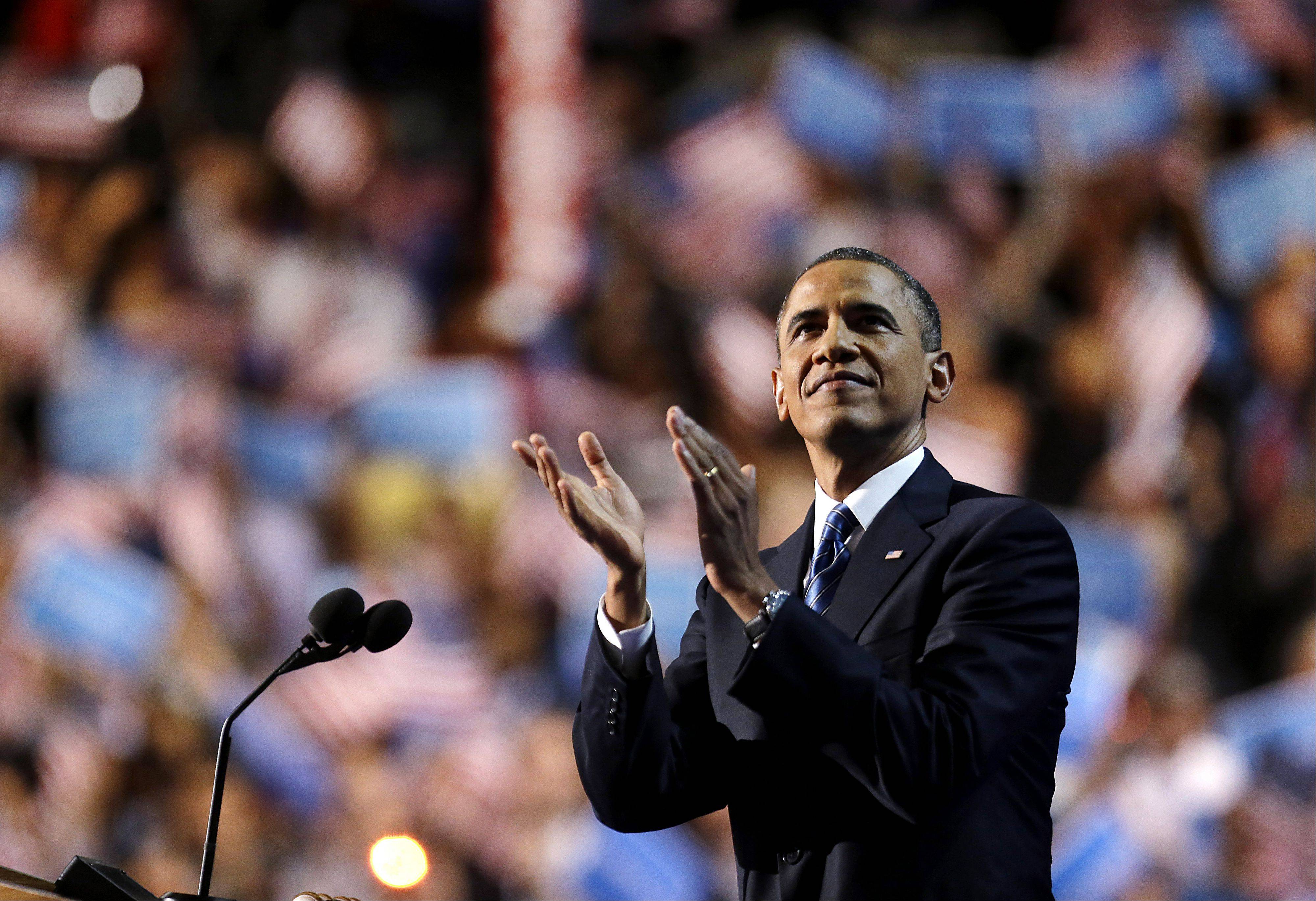 President Barack Obama admires the crowd before his speech to the Democratic National Convention in Charlotte, N.C., on Thursday, Sept. 6, 2012.