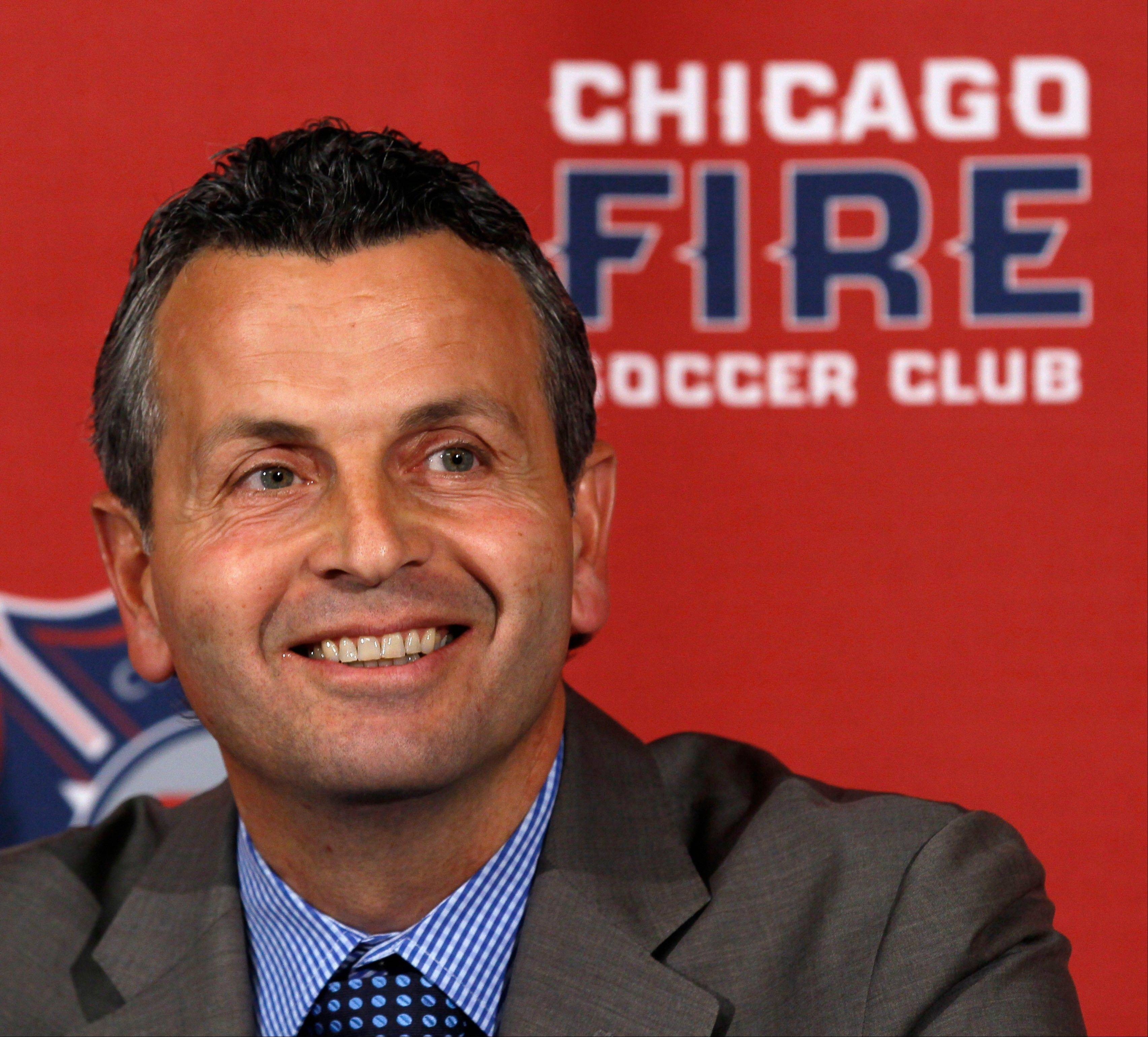 Frank Klopas smiles after being named head coach of the Chicago Fire MLS soccer team during a news conference at Toyota Park, Thursday, Nov. 3, 2011, in Bridgeview, Ill. Klopas was picked as the Fire's head coach on Thursday, five months after he got the job on an interim basis when the Major League Soccer club got off to a bad start. (AP Photo/Charles Rex Arbogast)