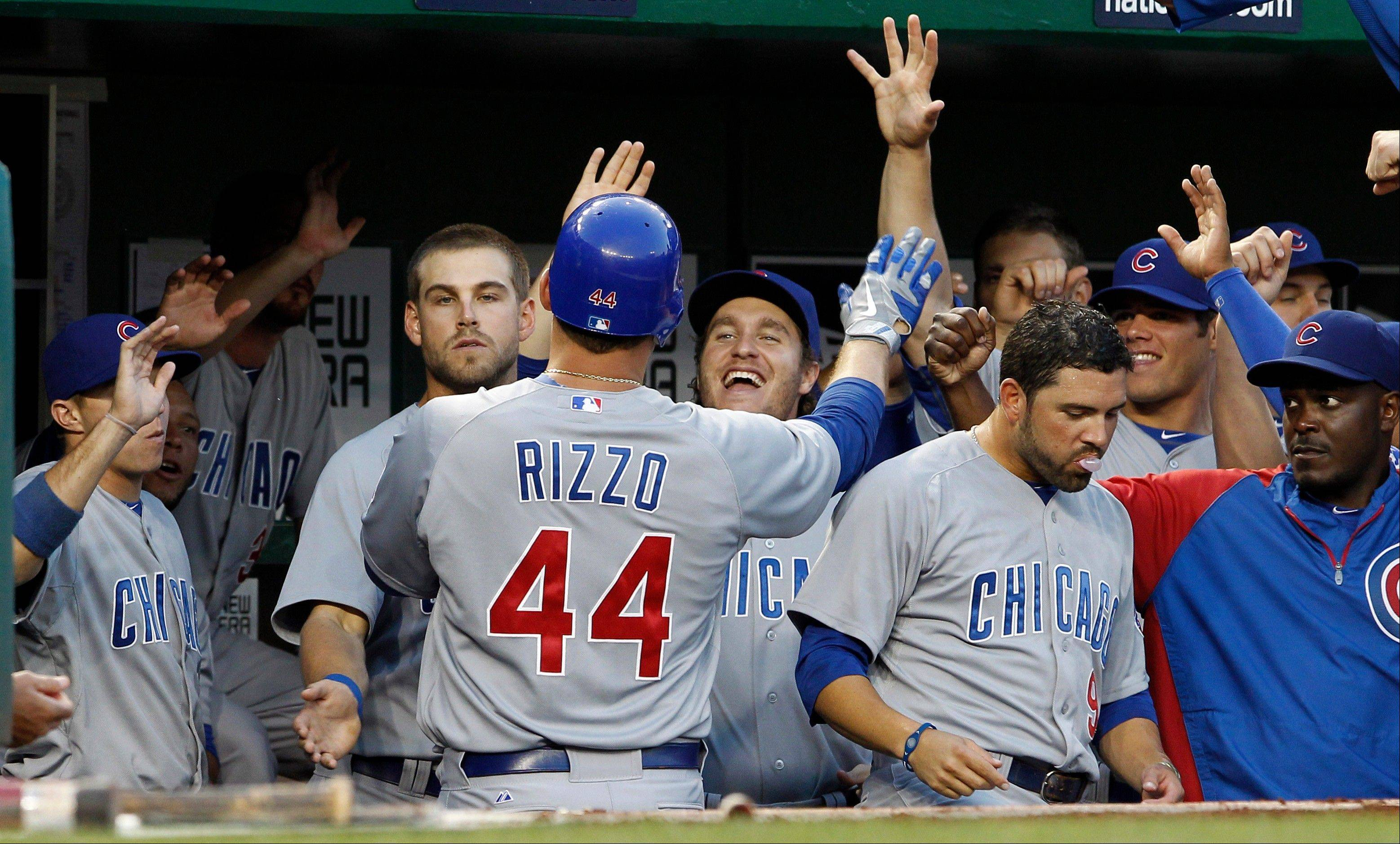 Chicago Cubs' Anthony Rizzo (44) celebrates with teammates after his solo home run during the first inning of a baseball game with the Washington Nationals at Nationals Park, Thursday, Sept. 6, 2012, in Washington. (AP Photo/Alex Brandon)