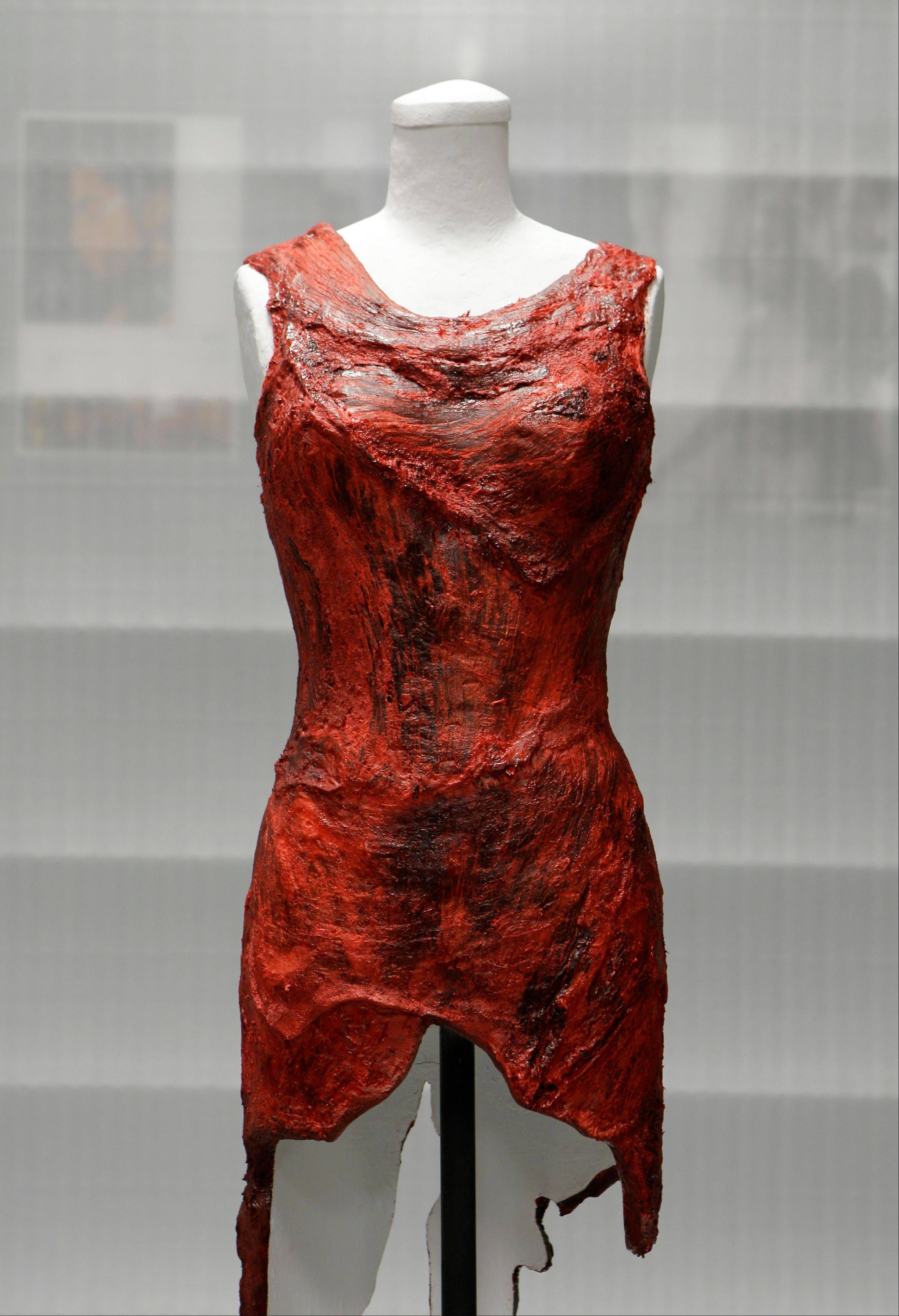 Lady Gaga's famous meat dress, now dried and painted, is being displayed at the National Museum of Women in the Arts with an explanation of her political message.