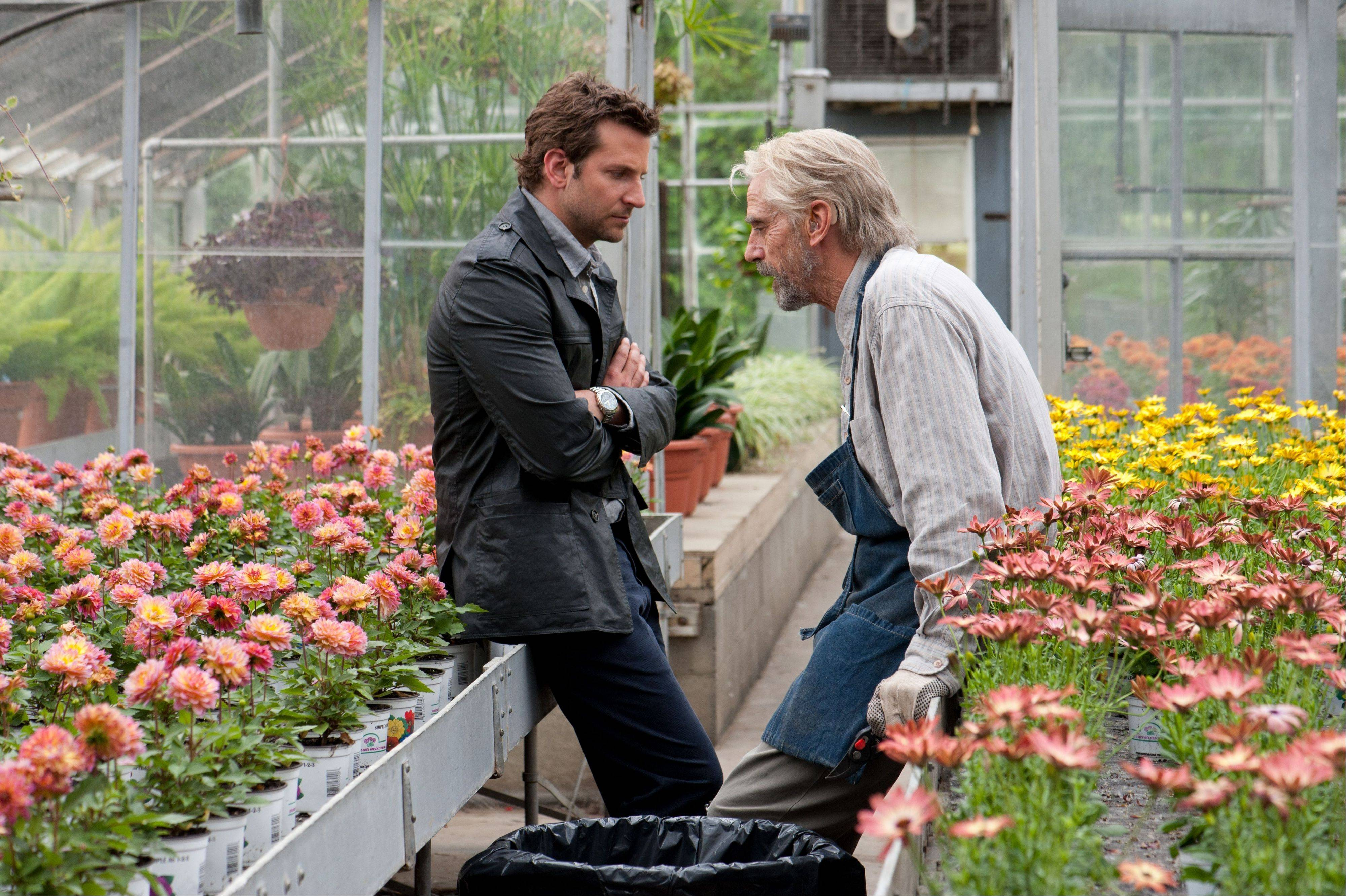"An old man (Jeremy Irons, right) confronts a writer (Bradley Cooper) with a secret in ""The Words."""