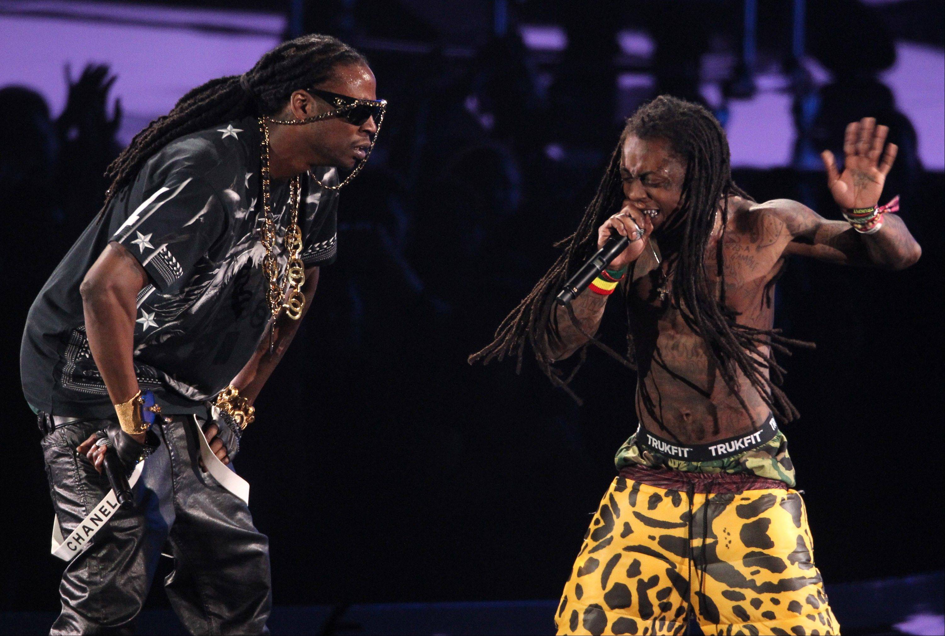 Lil Wayne, right, and 2 Chainz perform onstage at the MTV Video Music Awards on Thursday, Sept. 6, 2012, in Los Angeles.