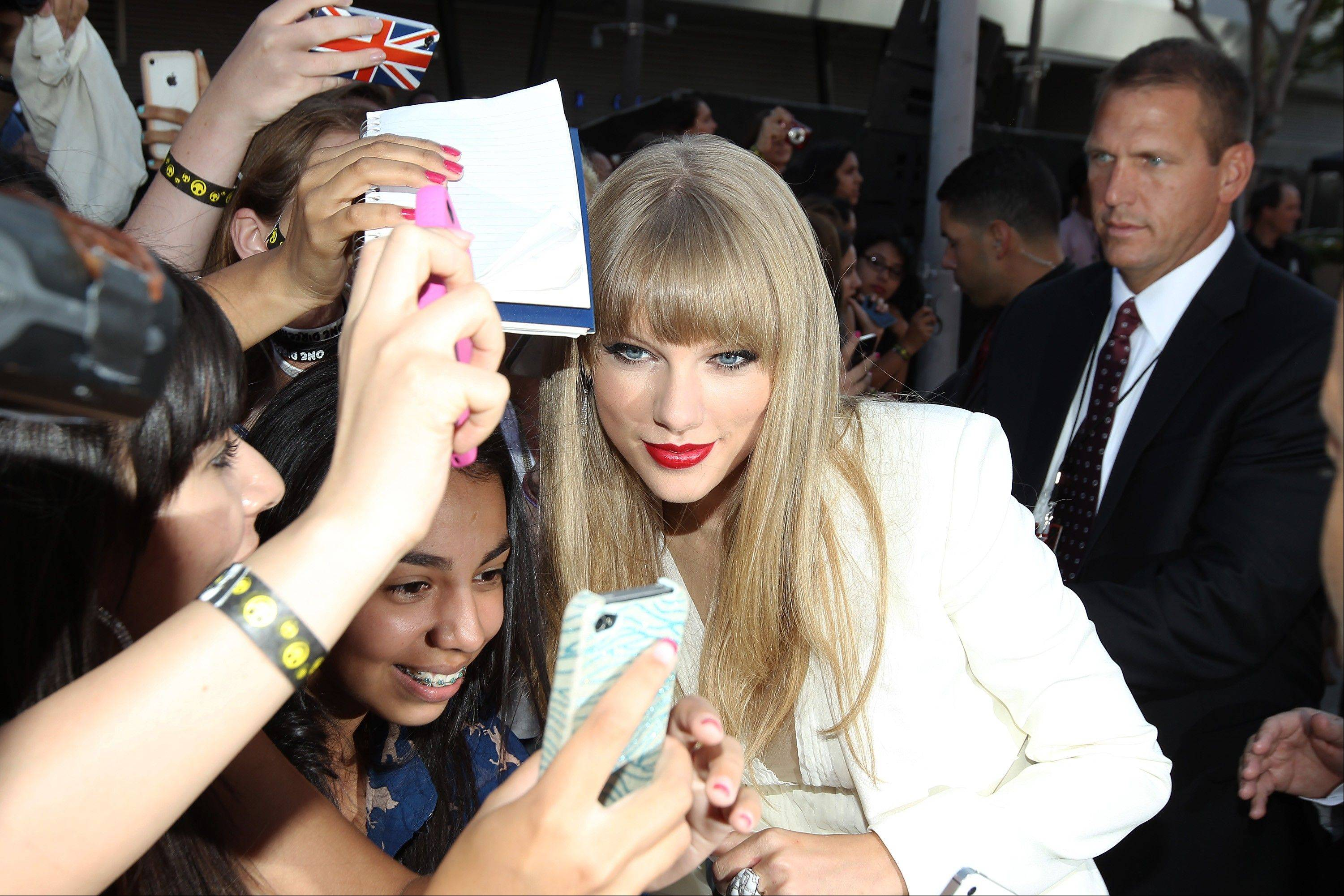Taylor Swift greets fans at the MTV Video Music Awards on Thursday, Sept. 6, 2012, in Los Angeles.