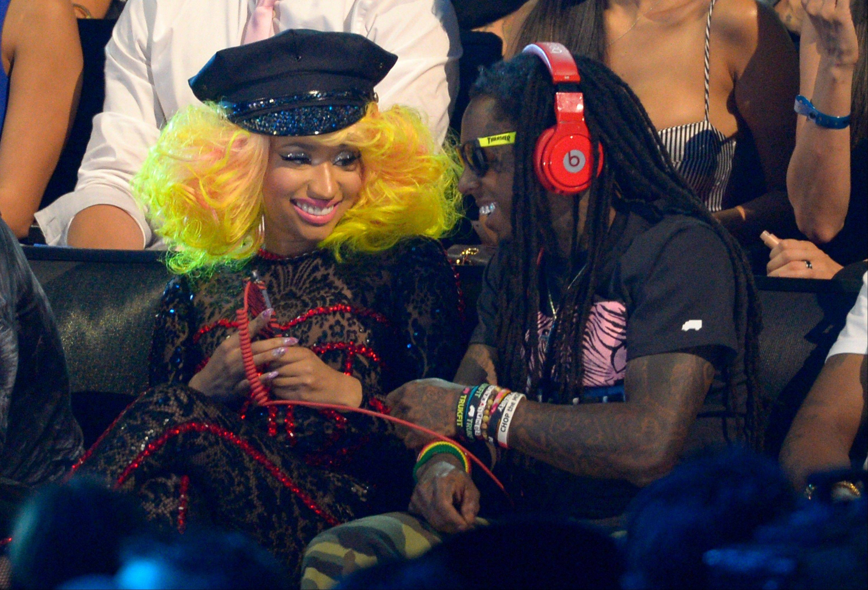 Nicki Minaj, left, and Lil Wayne sit in the audience in the audience at the MTV Video Music Awards on Thursday, Sept. 6, 2012, in Los Angeles.
