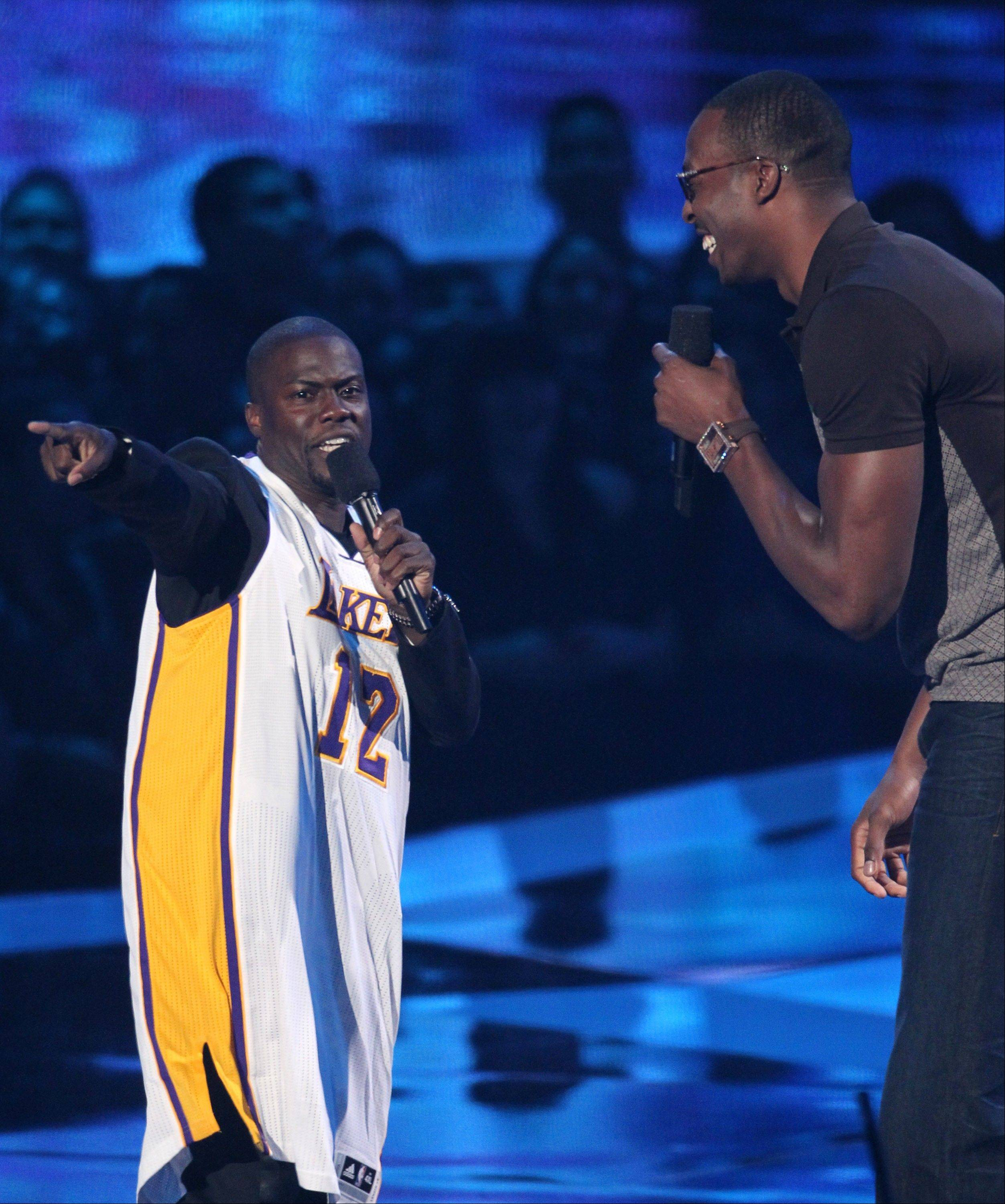 Host Kevin Hart, left, and Dwight Howard speak onstage at the MTV Video Music Awards on Thursday, Sept. 6, 2012, in Los Angeles.