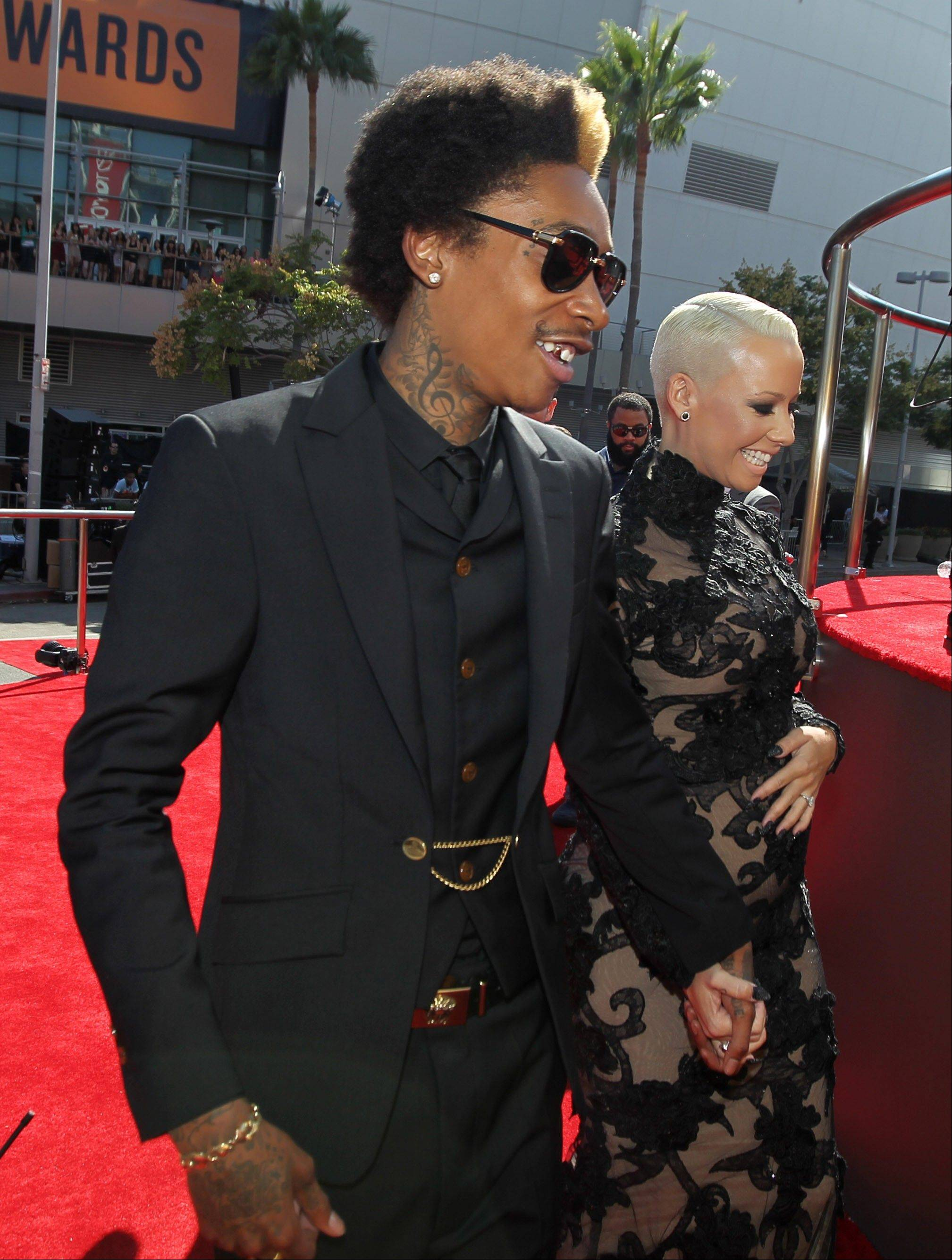 Wiz Khalifa, left, and Amber Rose arrive at the MTV Video Music Awards on Thursday, Sept. 6, 2012, in Los Angeles.