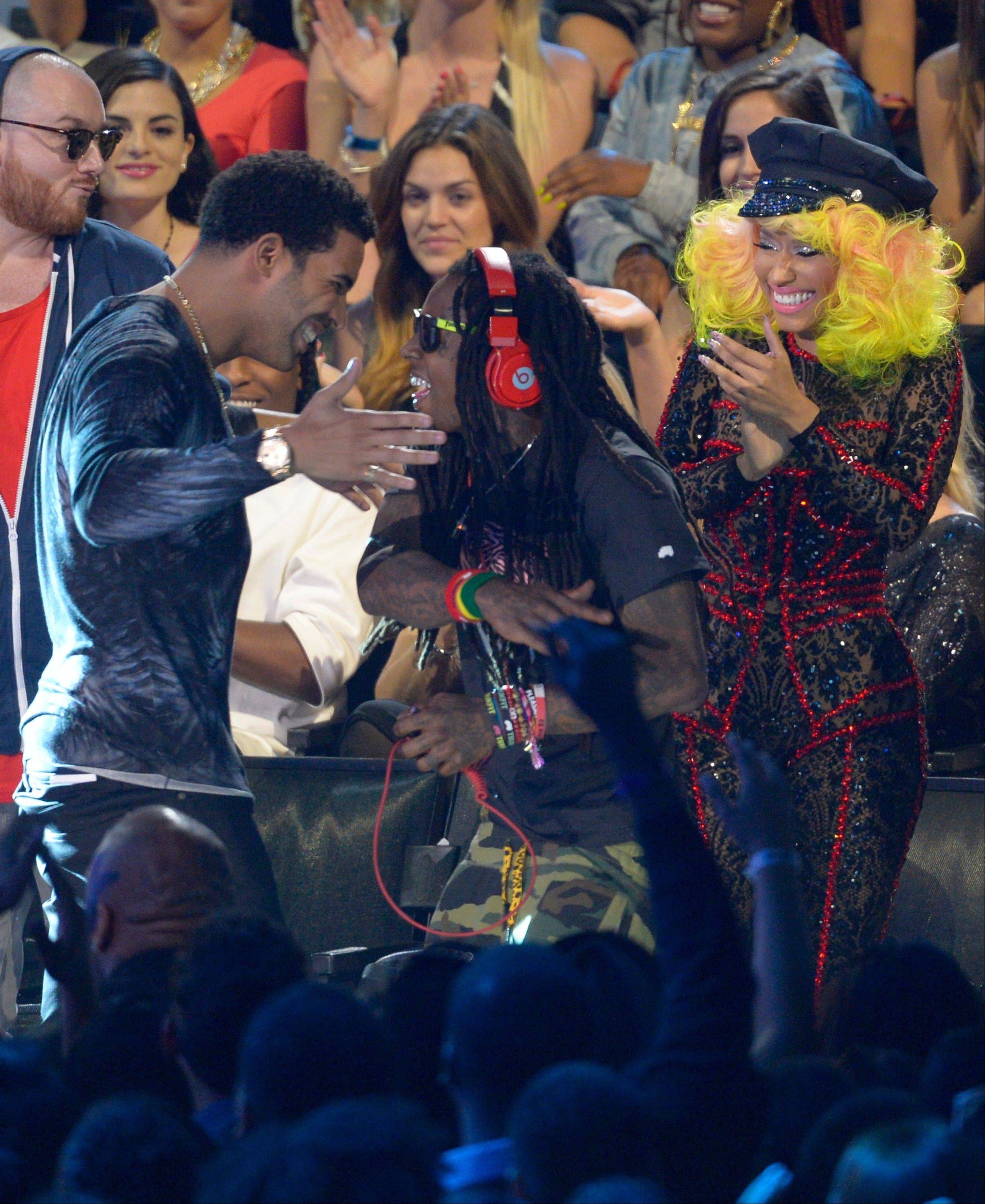 "Drake, left, Lil Wayne and Nicki Minaj walk onstage to accept the award for best hip-hop video for ""Hyfr"" at the MTV Video Music Awards on Thursday, Sept. 6, 2012, in Los Angeles."