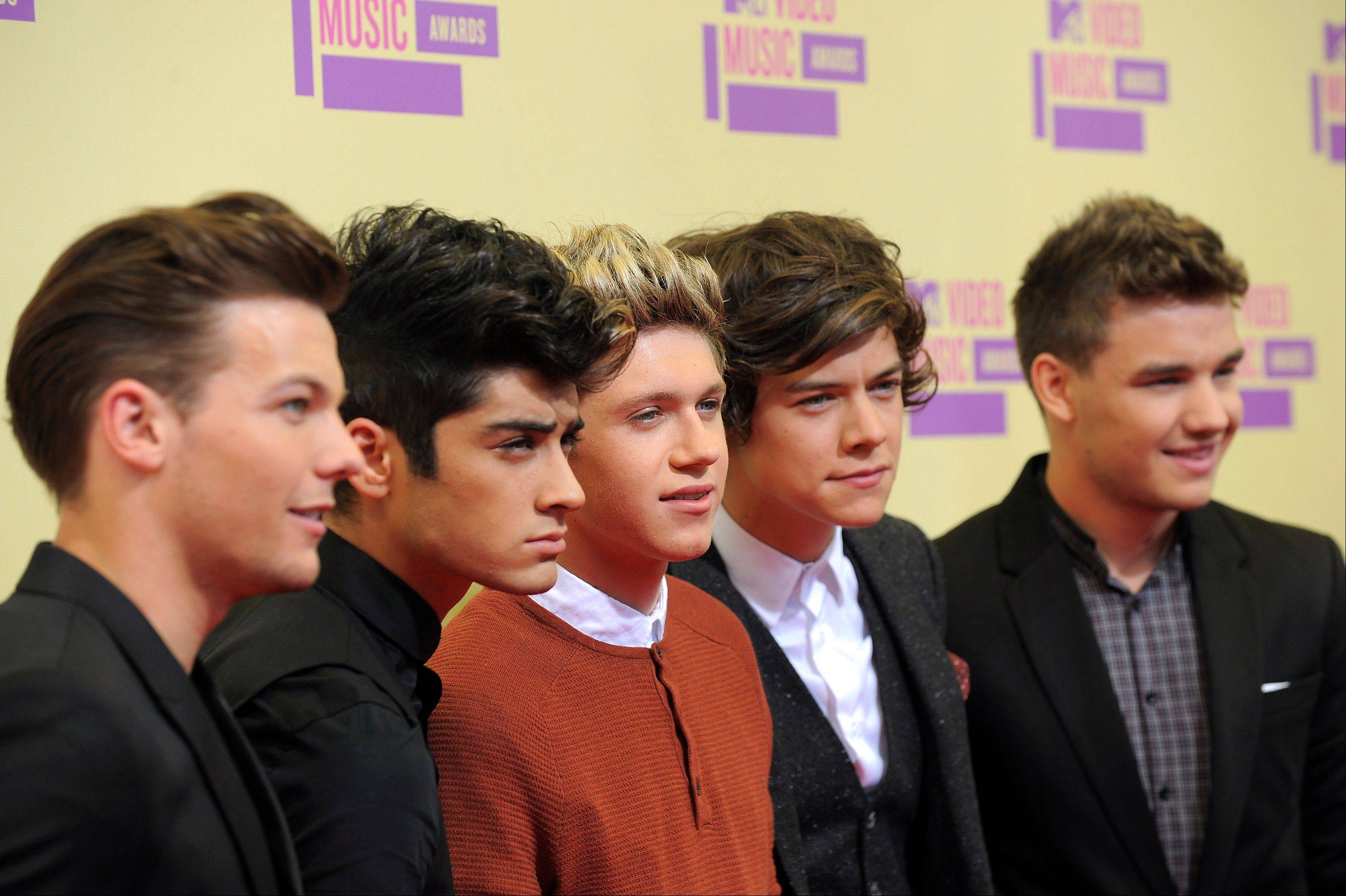 Members of the British band One Direction, from left, Louis Tomlinson, Zayn Malik, Niall Horan, Harry Styles and Liam Payne arrive at the MTV Video Music Awards on Thursday, Sept. 6, 2012, in Los Angeles.