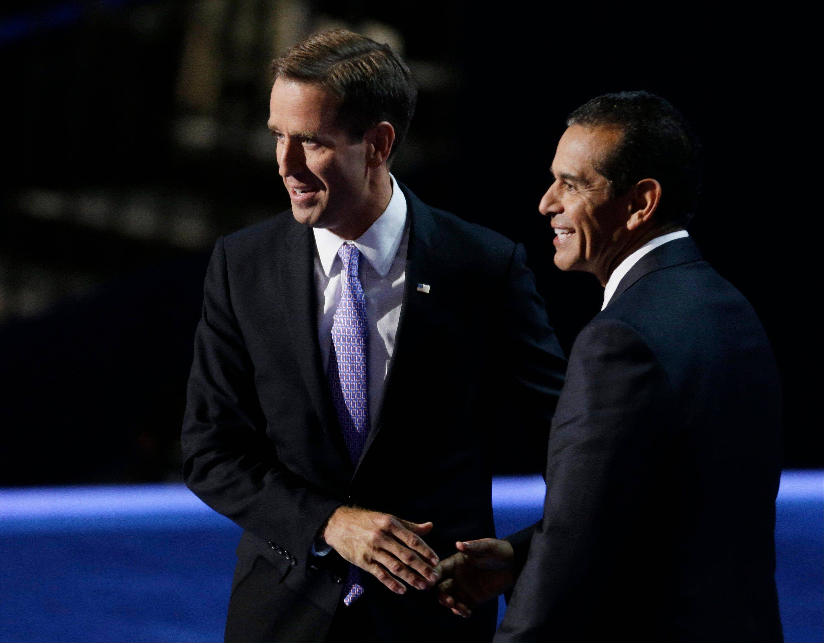 Los Angeles Mayor and Democratic Convention Chairman Antonio Villaraigosa, right, greets Beau Biden, attorney general of Delaware and son of Vice President Joe Biden, during the Democratic National Convention in Charlotte, N.C., on Thursday.