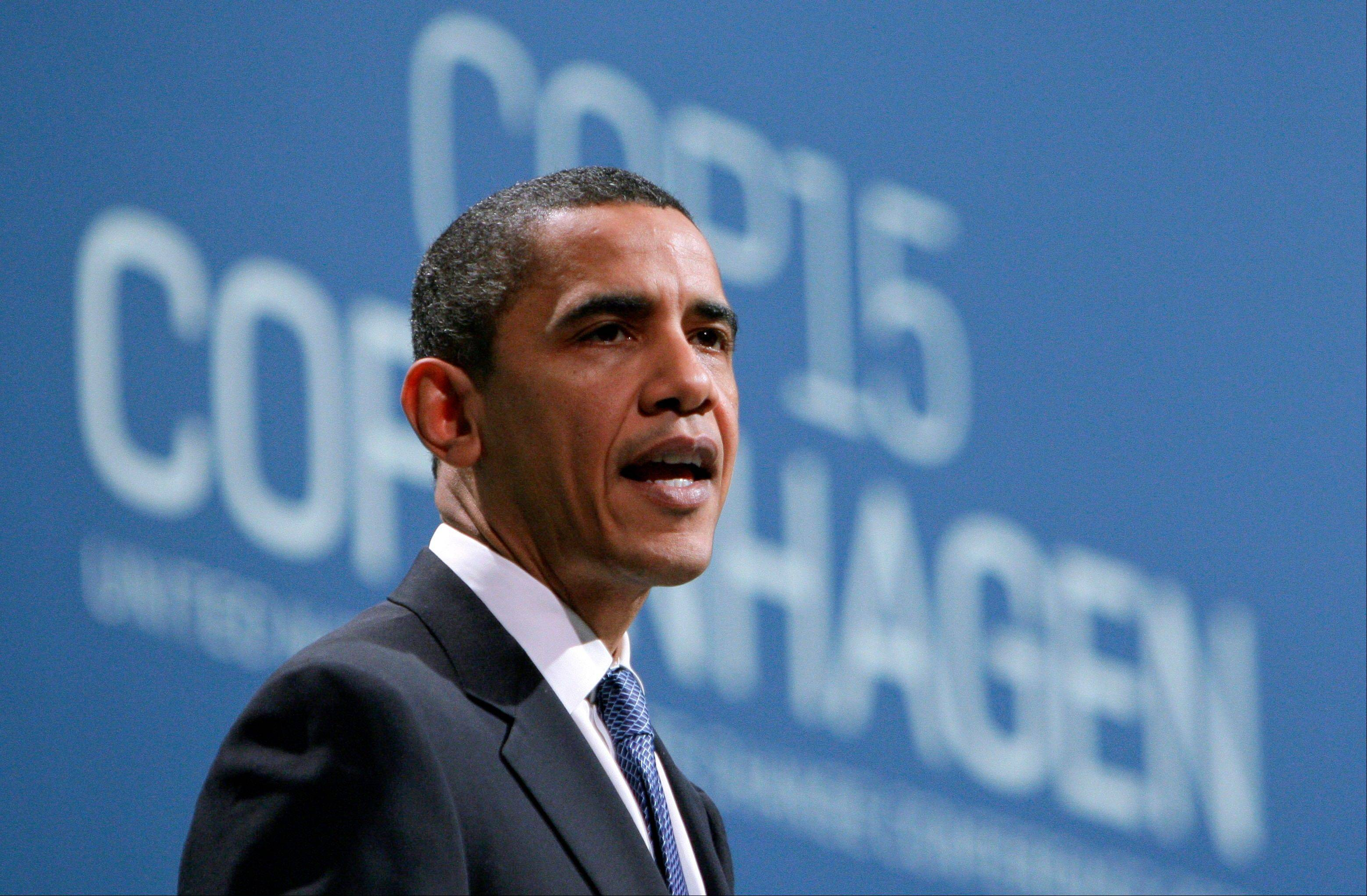 In this Dec. 18, 2009, file photo, President Barack Obama speaks at the climate summit in Copenhagen, Denmark. Three topics are noticeably missing from the Democrats' meeting: Climate change, economic stimulus and the massive bank bailout.