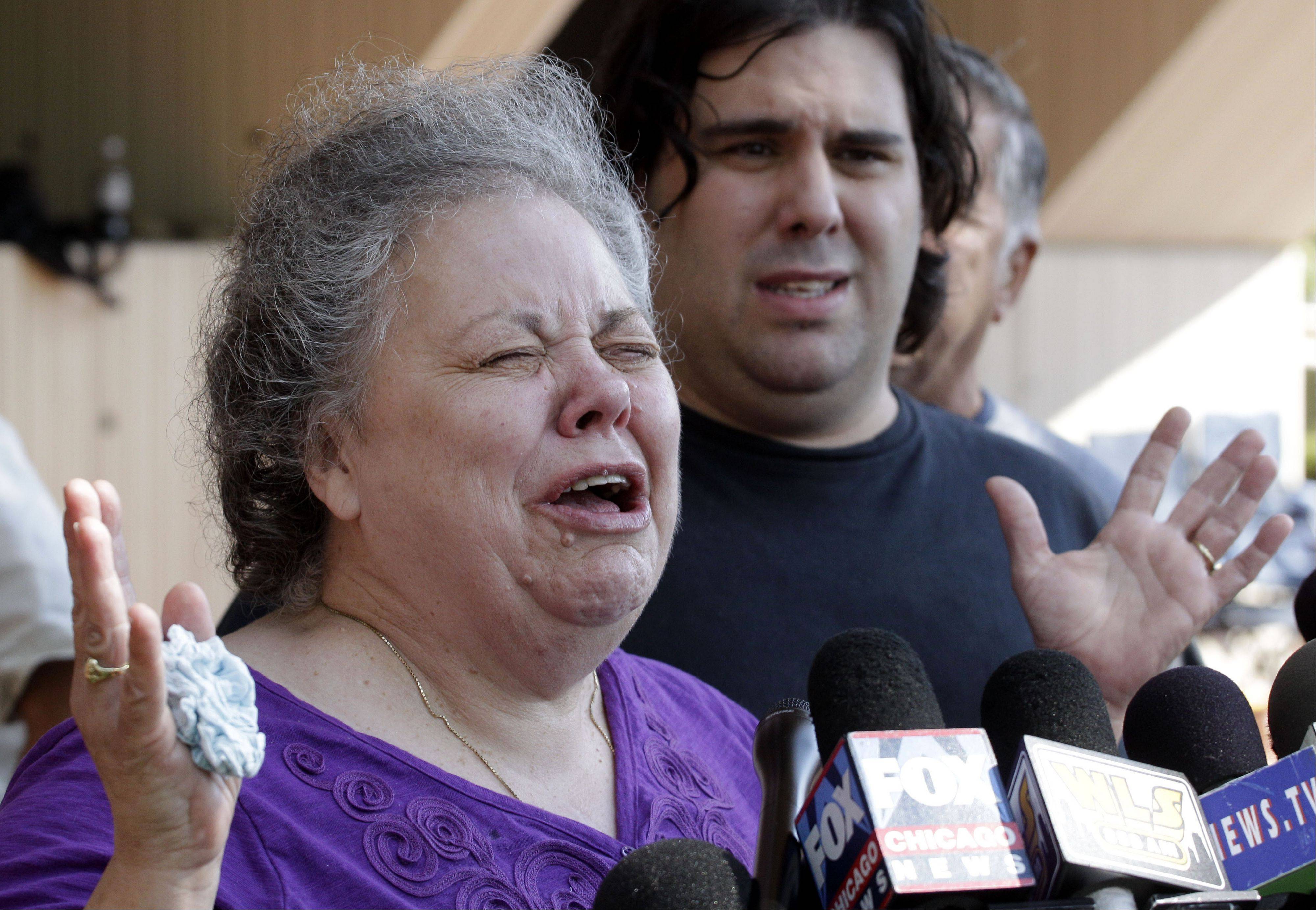 Marcia Savio, step-mother of Kathleen Savio cries outside the Will County Courthouse after word that former Bolingbrook police officer Drew Peterson was found guilty of murdering his third wife Kathleen Savio Thursday, Sept. 6, 2012, in Joliet, Ill. Marcia Savio is accompanied by Kathleen Savio's half-brother Nicholas Savio.