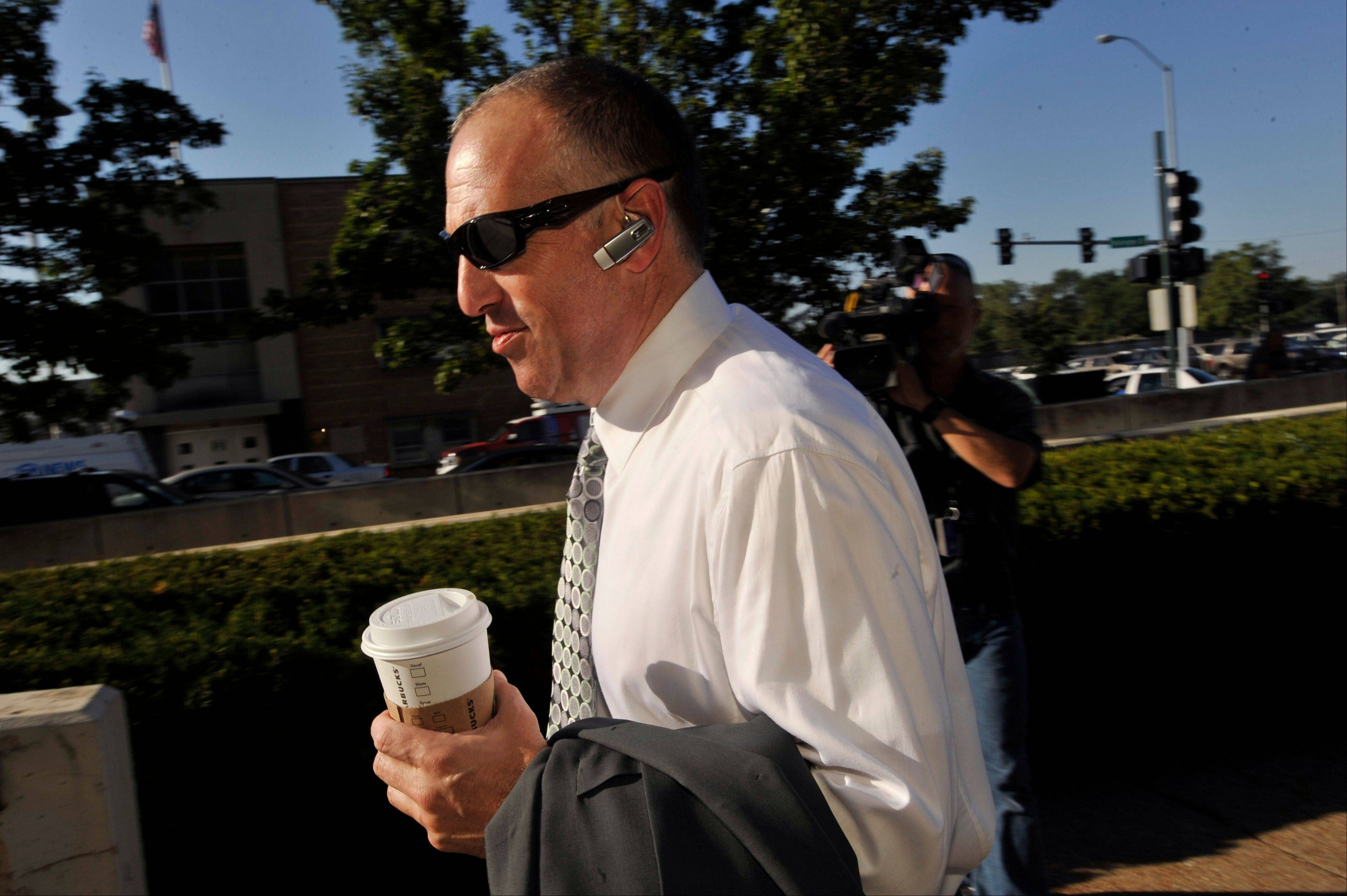 Attorney for Drew Peterson, Steven Greenberg, walks to the Will County Courthouse during the second day of jury deliberations in Peterson's murder trial, Thursday, Sept. 6, 2012, in Joliet, Ill.