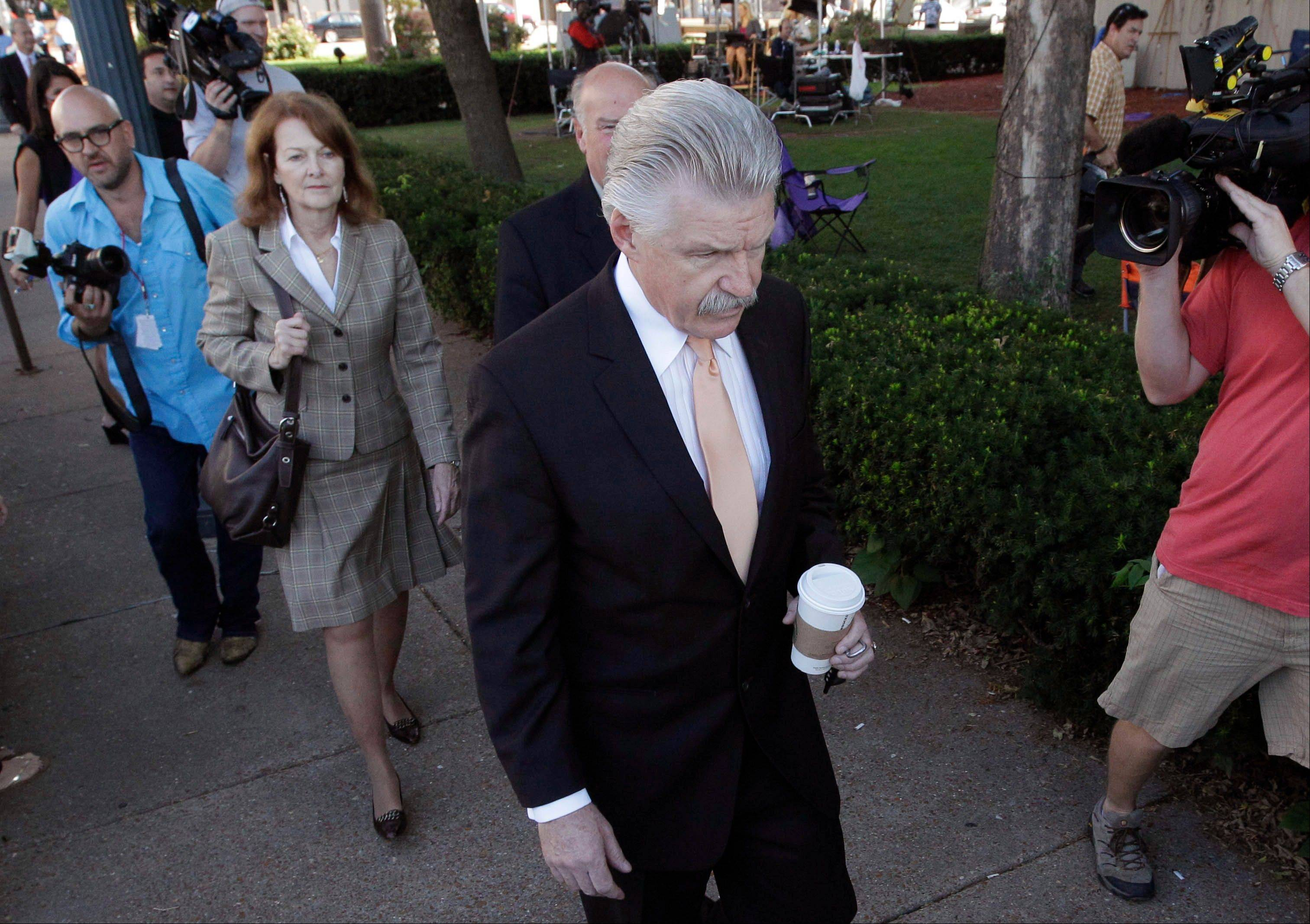 Will County States Attorney James Glasgow walks to the Will County Courthouse during the second day of jury deliberations in the Drew Peterson murder trial, Thursday, Sept. 6, 2012, in Joliet, Ill.